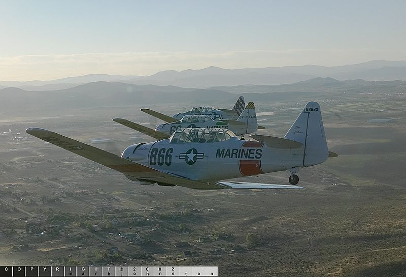 """In the air with a group of T-6 """"Texans"""" on the way back to the barn after an early morning fly-over of Reno to promote the Air Races."""
