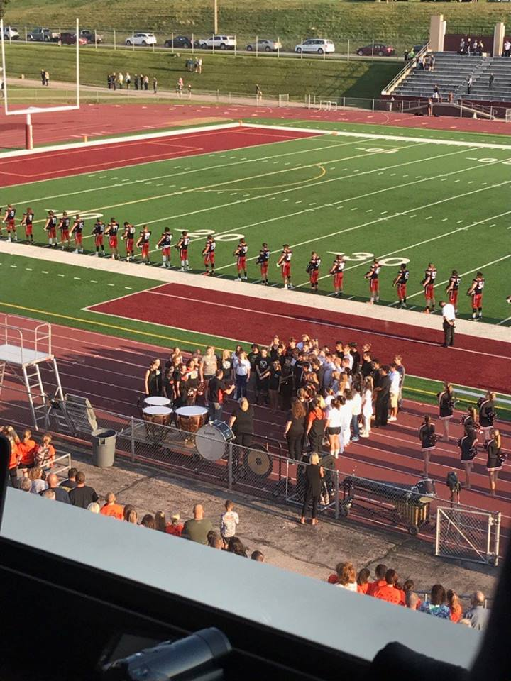 Singers from EHS and Heelan sing the National Anthem