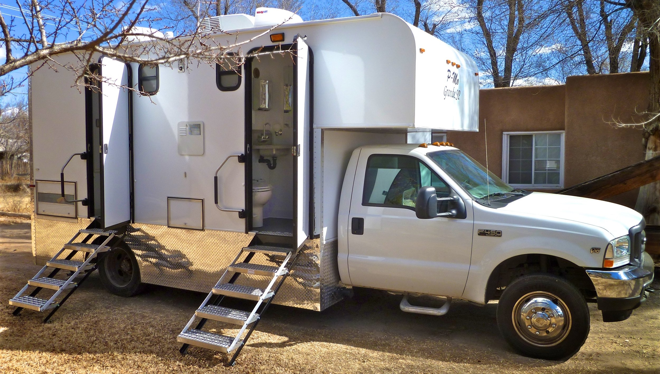 "Mobile  truck with restrooms. Four restrooms each with toilet & sink. ""P-Mo Grande SP"". Call Wayne Elliott for details (505) 328-0909.     ElliottLocationEquipment.com"