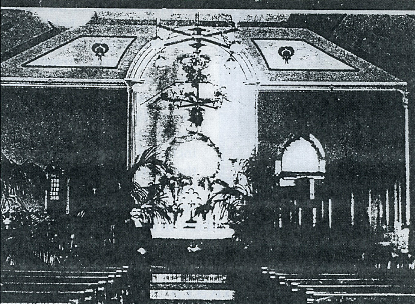Picture, taken in 1914, of the early church interior with Pastor Schlick standing just left of center. Note the dark walls, the chandeliers, the Greek columns either side of the recessed alter, the pulpit on the right side (where later Carl Schmidt was to build a pipe organ with discarded parts salvaged from rebuilt organs) the window behind the pulpit indicating the parsonage had not yet been constructed, and the palms a symbol that the picture was taken during the Easter Season. Also! the early church was serviced by a reed organ that was pumped with the feet to build up air in the chambers, and when the keys where played - sound was generated. Bertha Oelschlager was organist for many many years prior to Carl Schmidt's tenure which ended with his death in 1982.