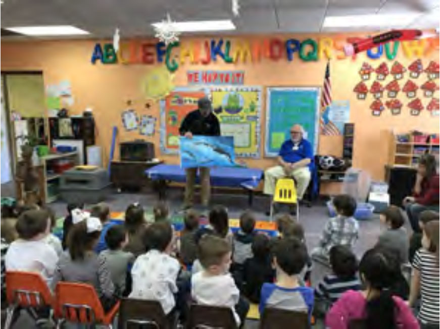 "The National Aviary read a book about Penguins to the students prior to introducing ""Disco""."