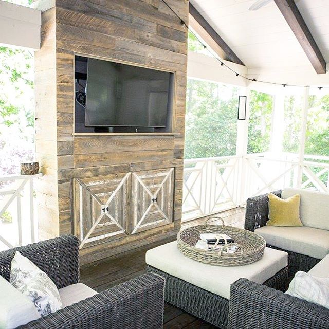When one of the most talented interior designers calls you and wants to collaborate on an epic outdoor installation, you say yasss. . @katnelsondesigns designed this porch as part of a larger, dang gorgeous renovation in a home outside of Atlanta last year and we just got the pics back. 📷 . Reclaimed cypress wall + barnwood detail for the cabinet doors to mimic the porch design. I might ask the client if I can throw porch parties when she's gone 🙃