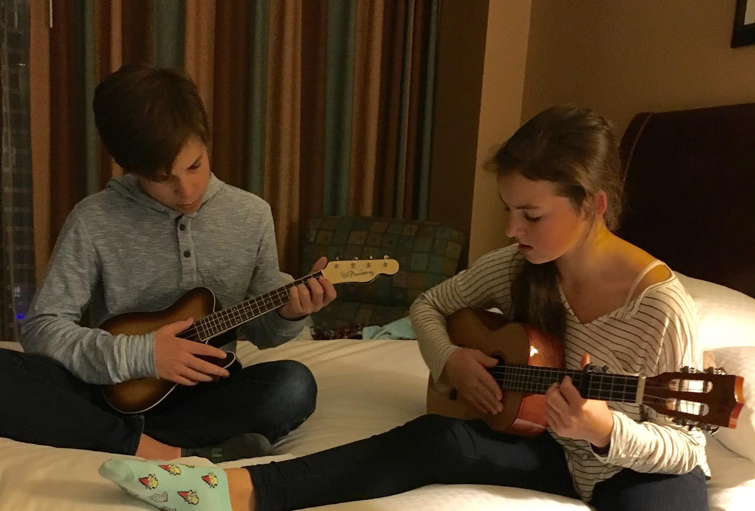 Practicing ukulele in the hotel