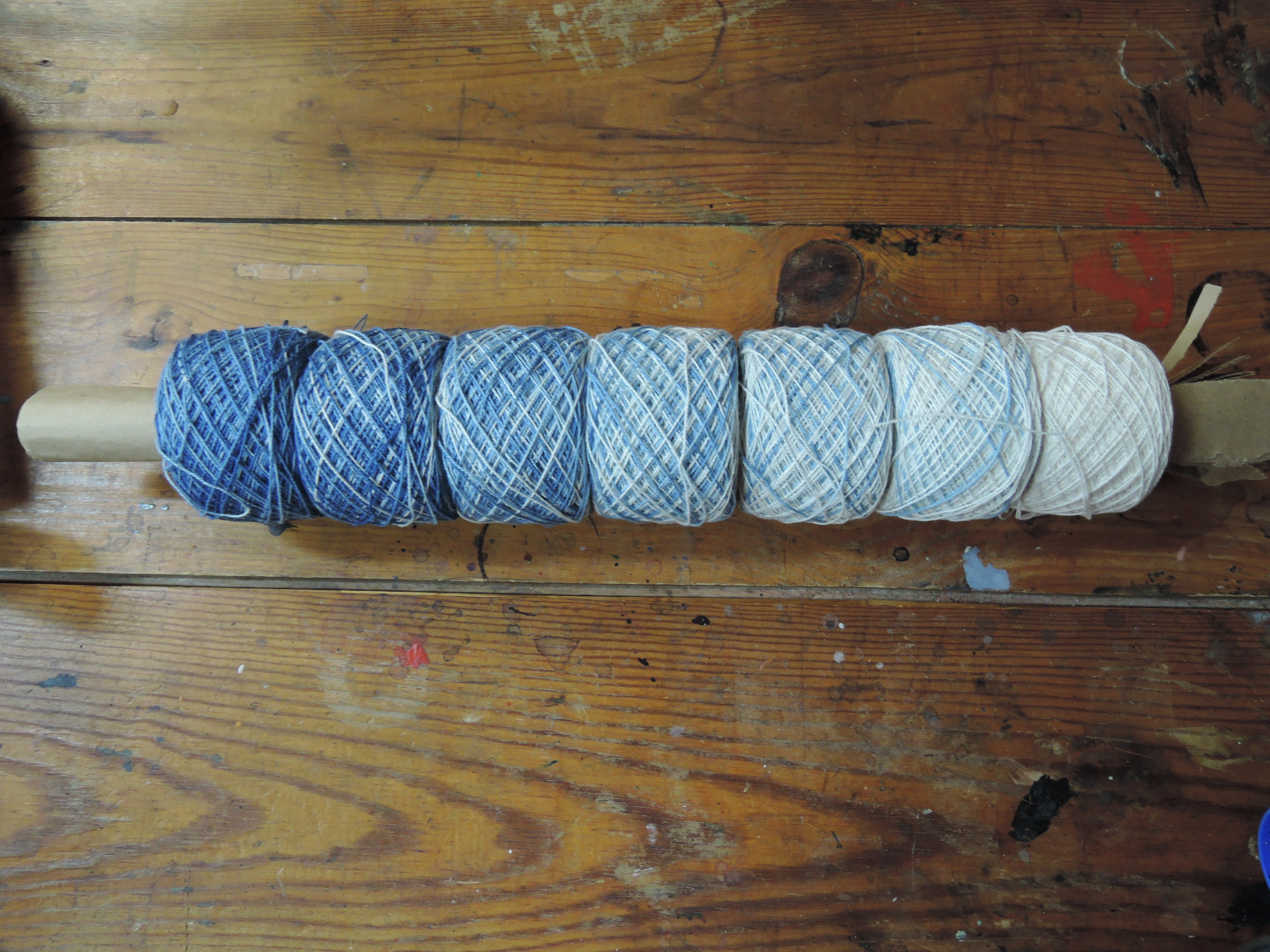 The yarn is dyed, dryed, balled, and ready for weaving.