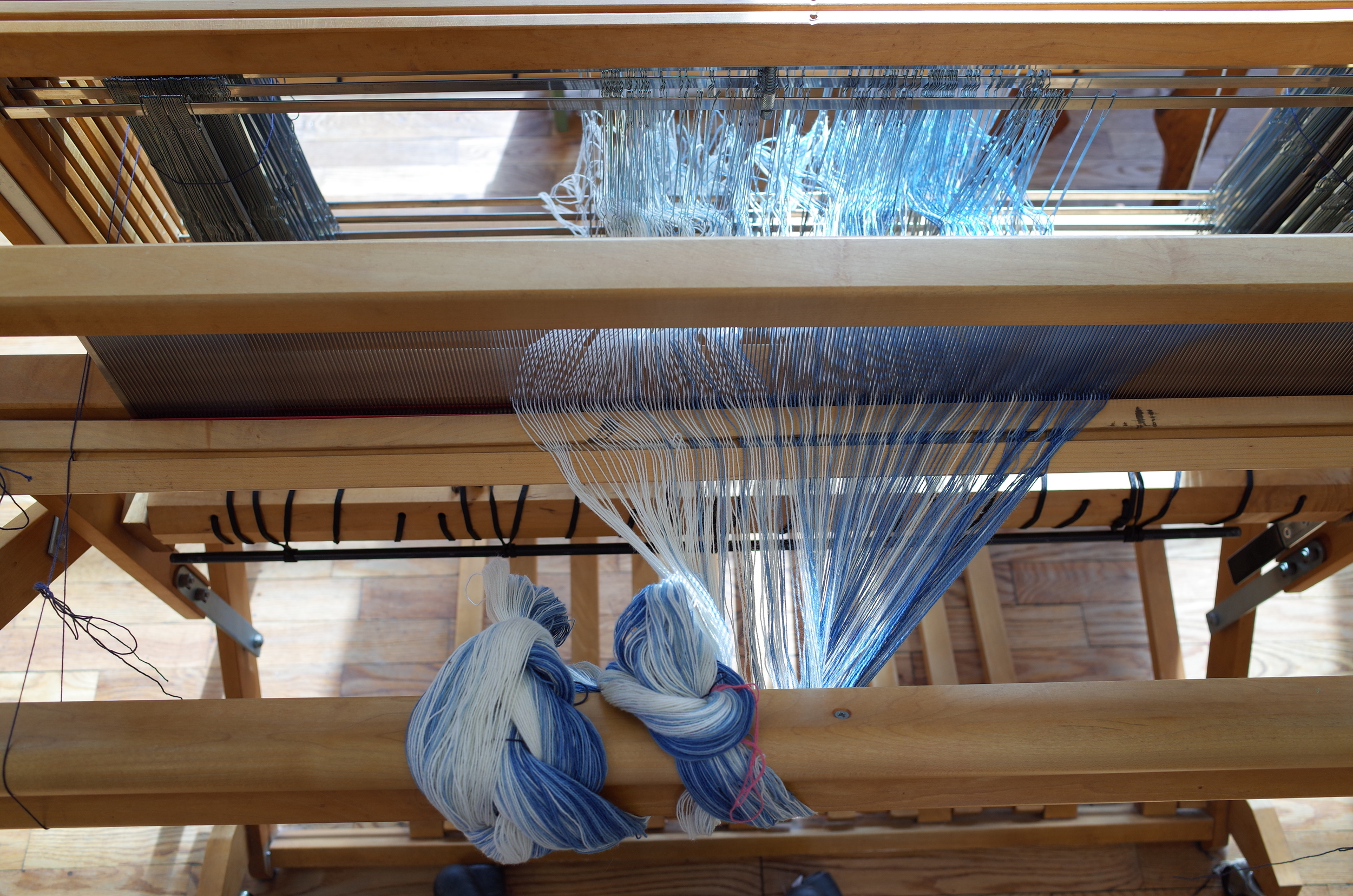 View of the threaded heddles and reed.