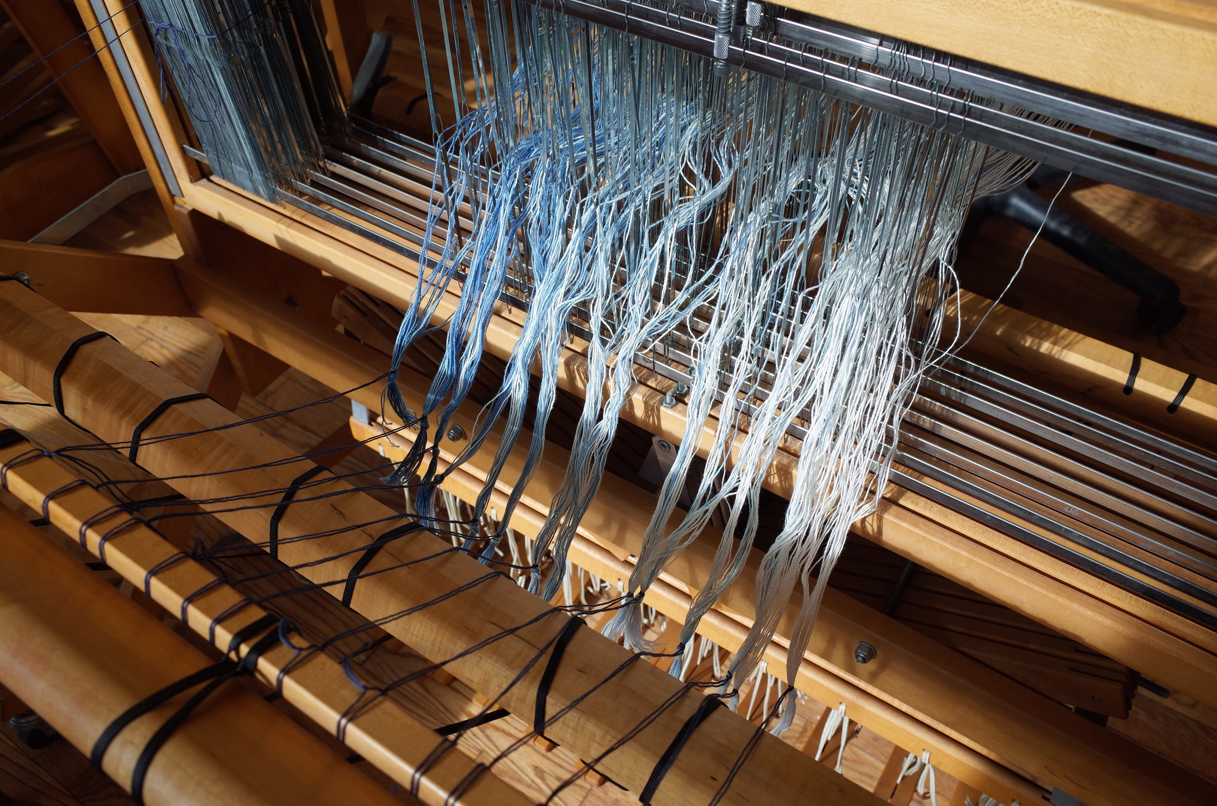 The warp is tied onto the back.