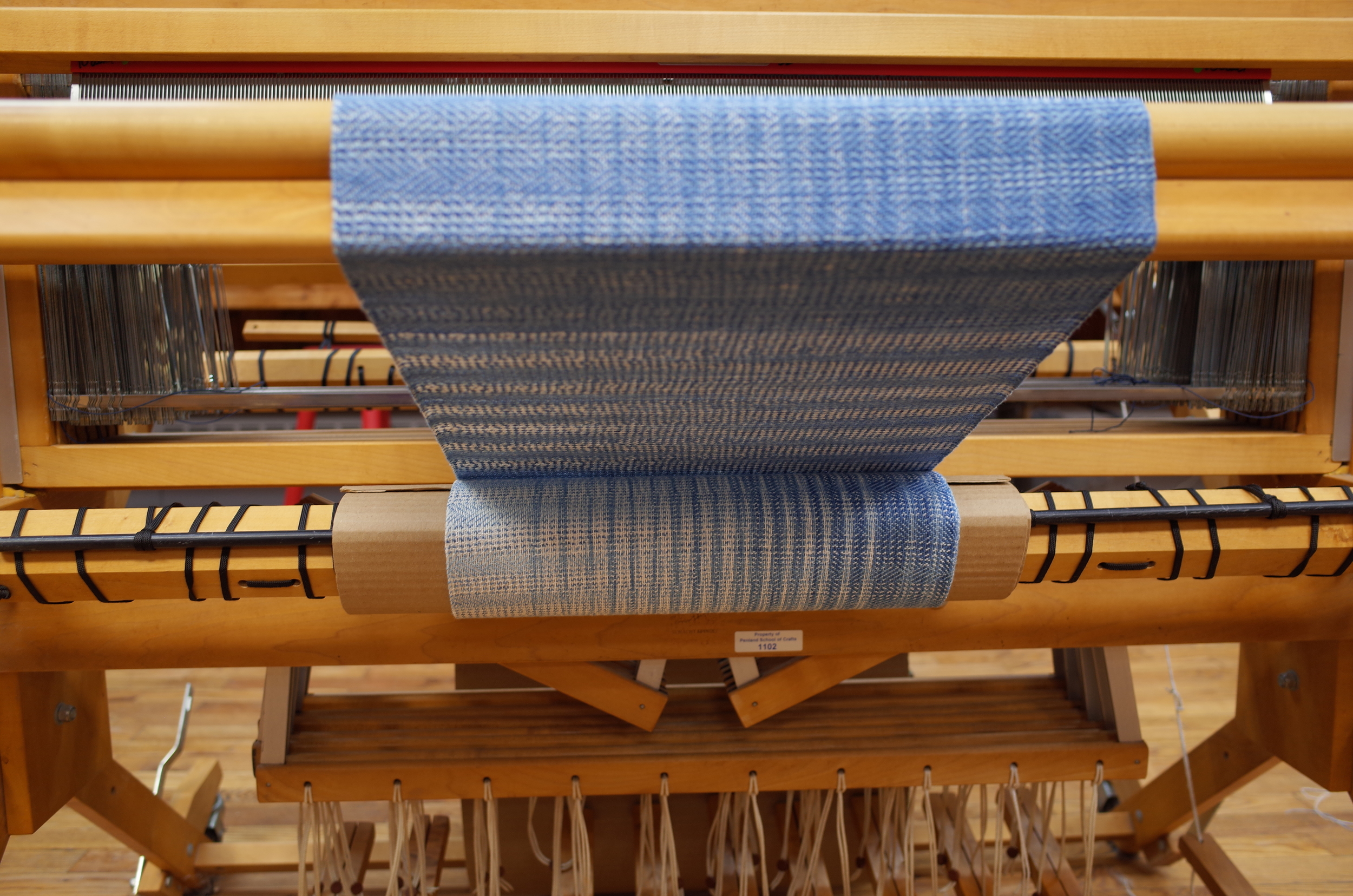 Finished weaving wound onto the front beam.