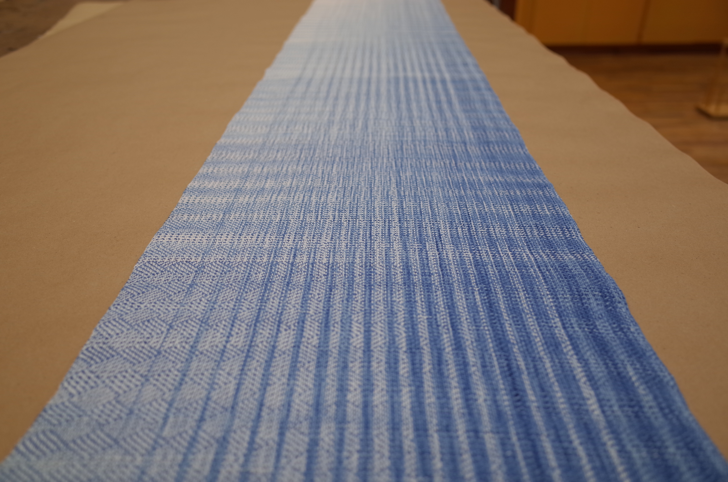 Off the loom and ready for finishing.