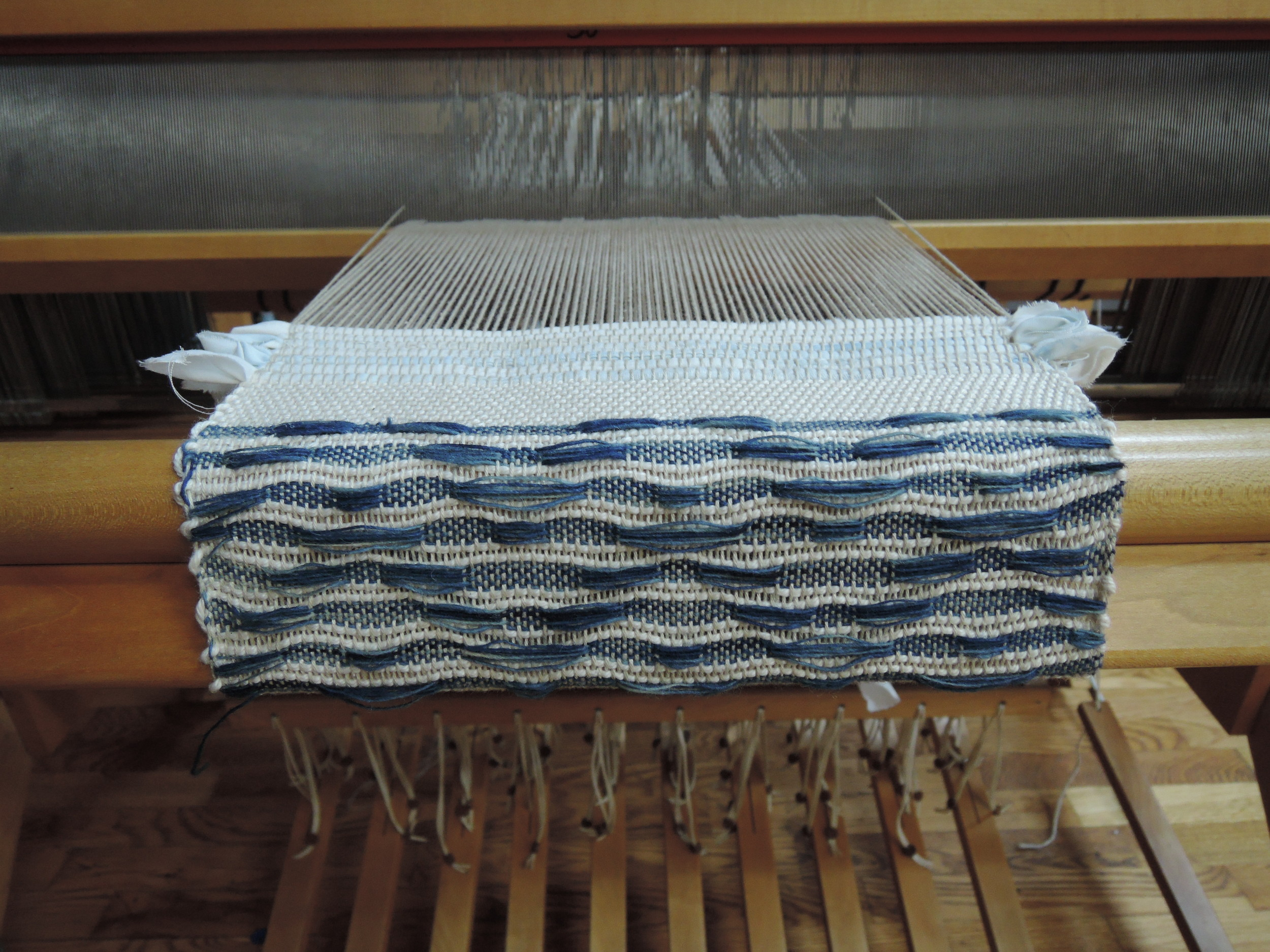 Sometimes it's easier to weave upside down so that I have to lift less harnesses with each treadle.