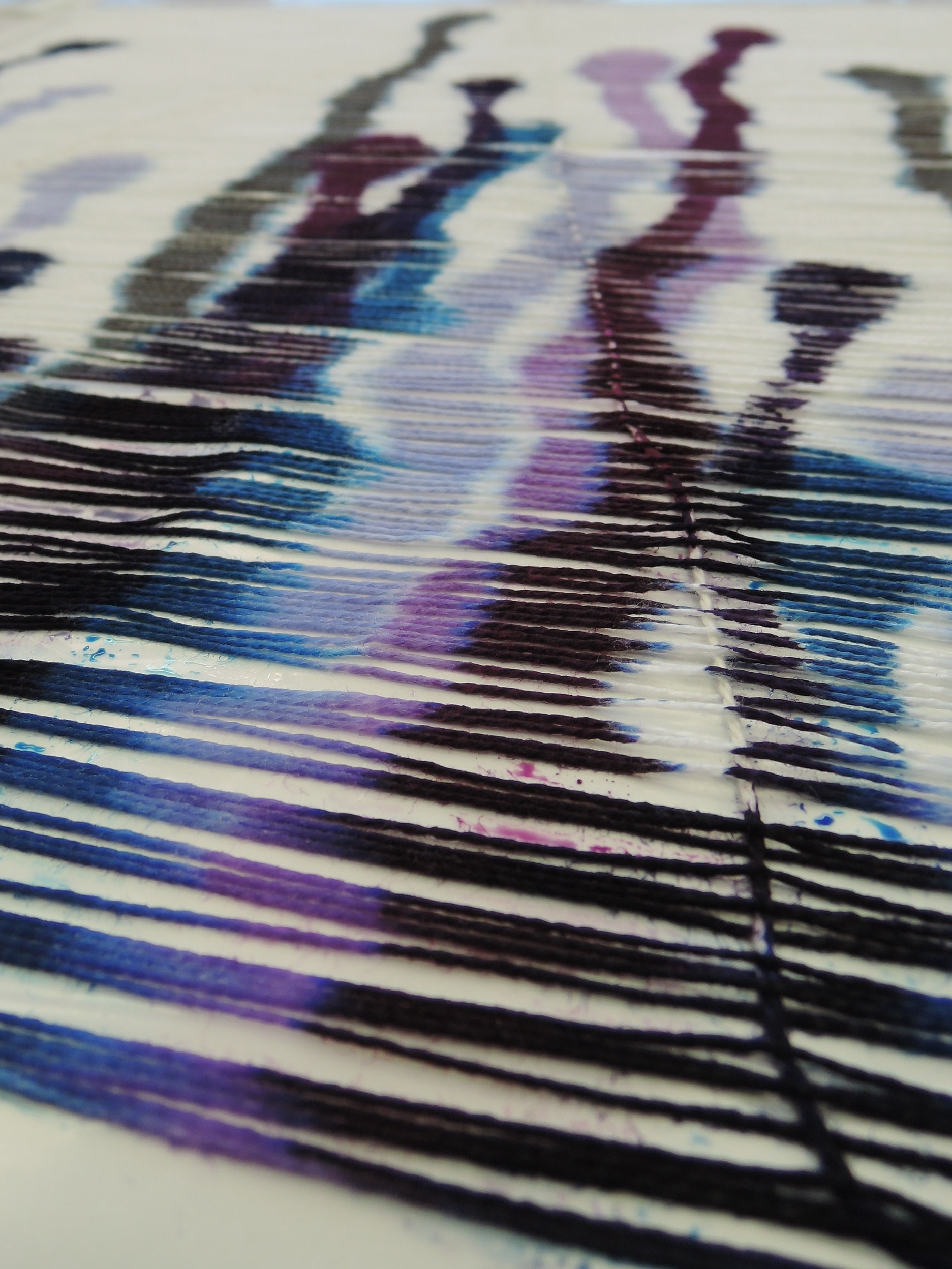 One of the weft threads keeping all the warp threads in line throughout this process.