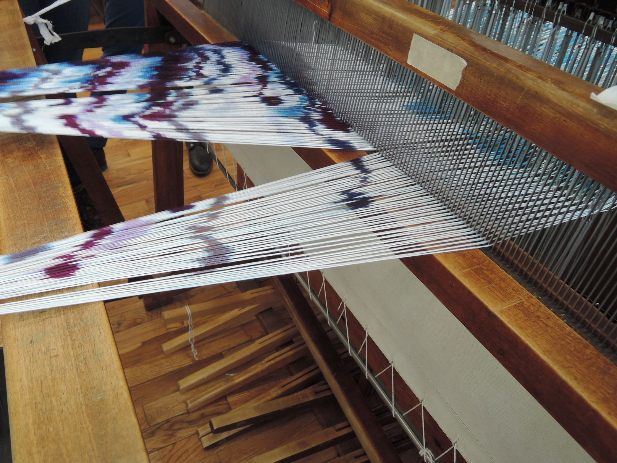 Winding the warp on for a second time.
