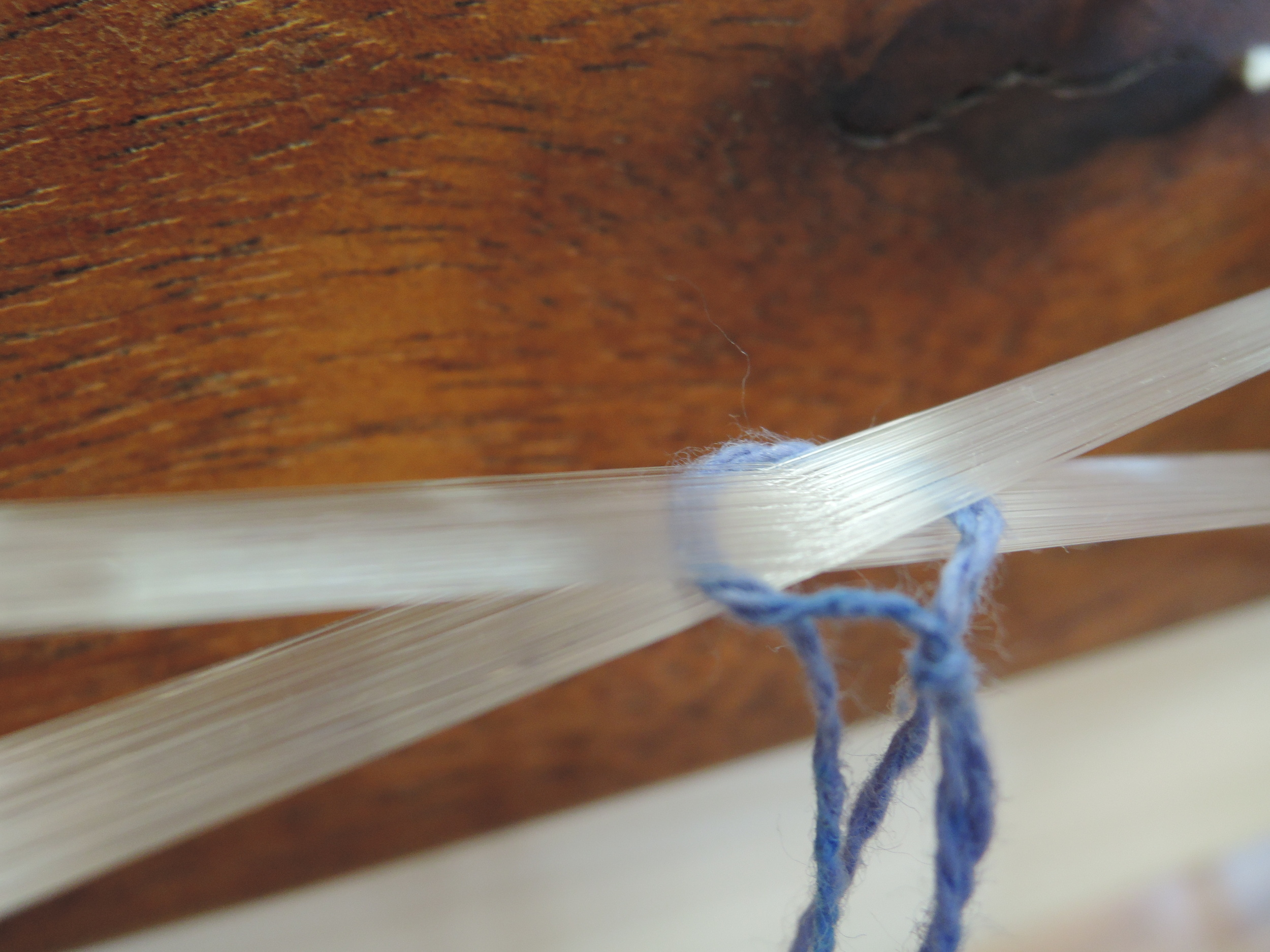 This is the cross that keeps every single one of these fibers in exactly the same order as I dress the loom.
