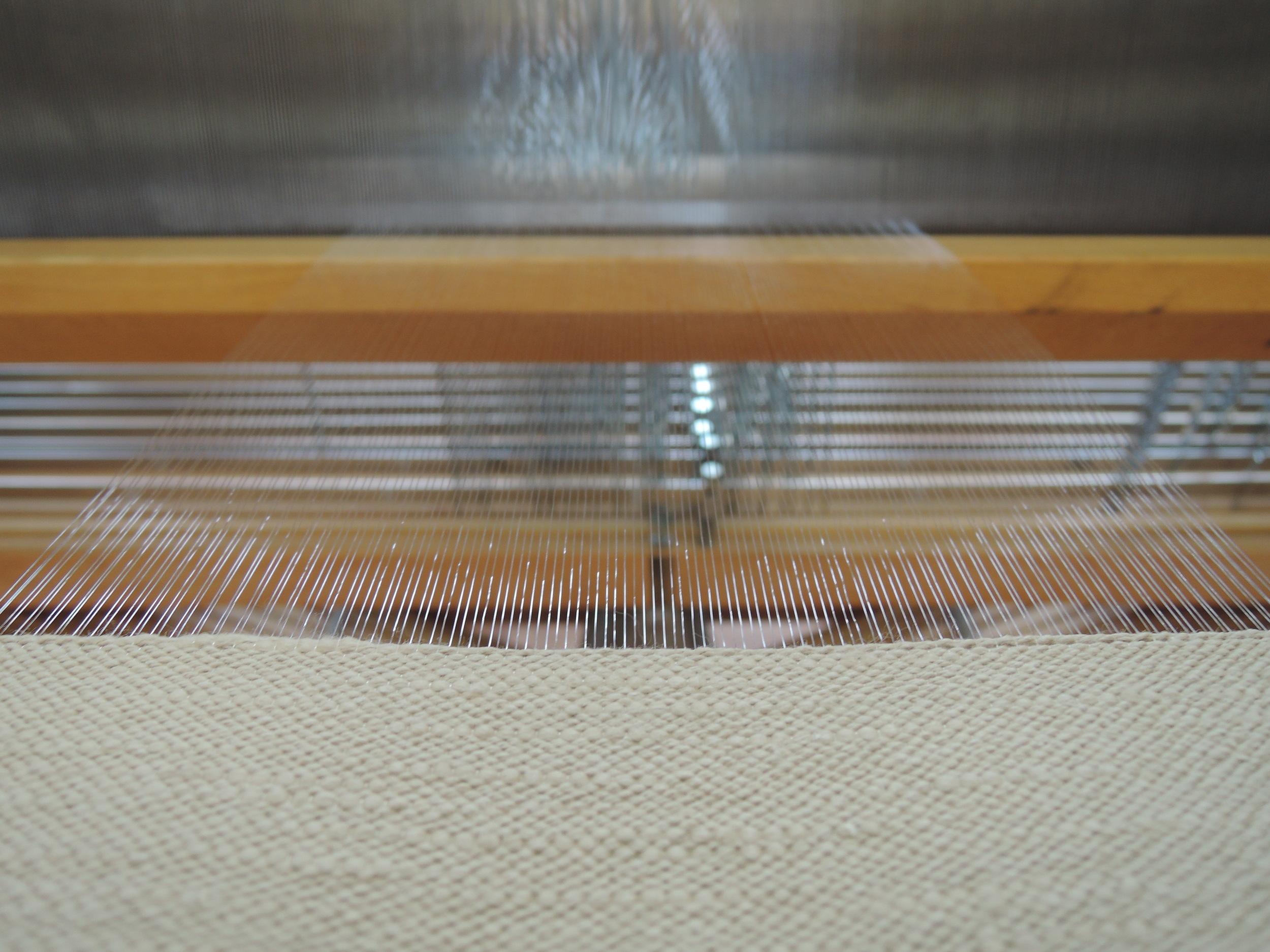 Weaving on the beautiful, clear warp.
