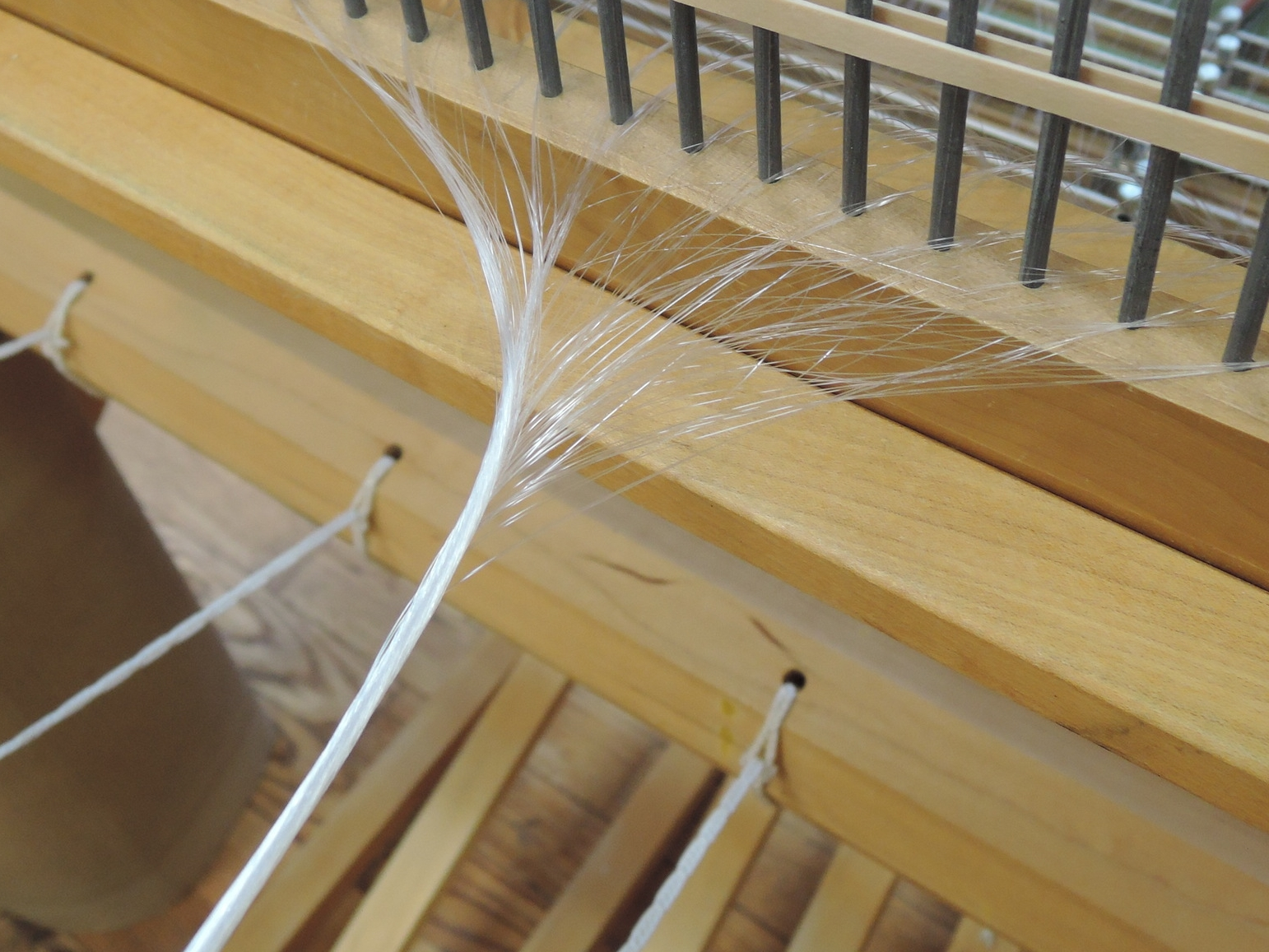 Dressing the loom with invisible threads.