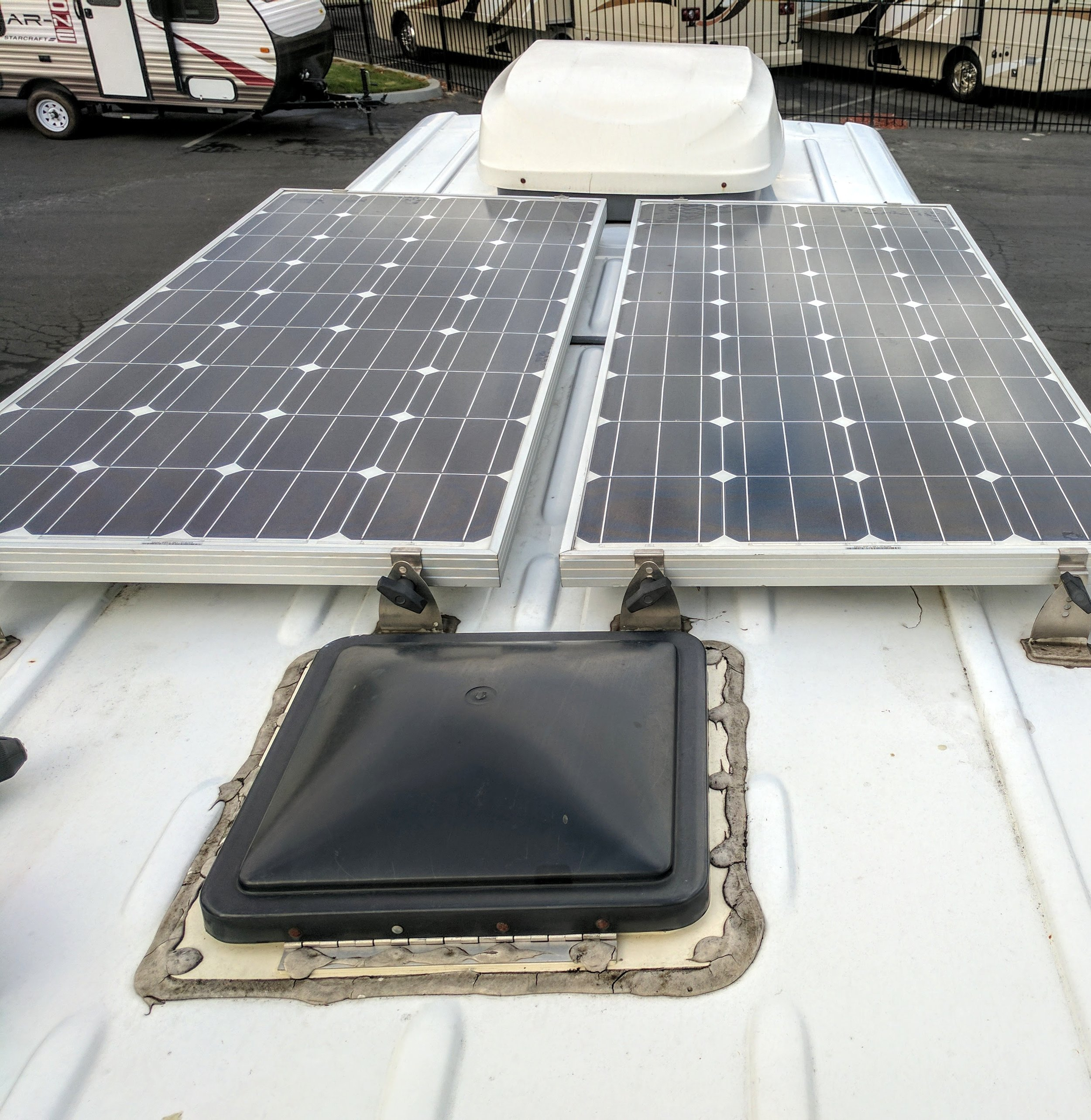 Speaking of AM Solar, I had them install 320 watts of solar panels to the roof. They generally do a great job of keeping my gadgets all charged up (and my lights on and water running) even when the van has been parked for days on end.