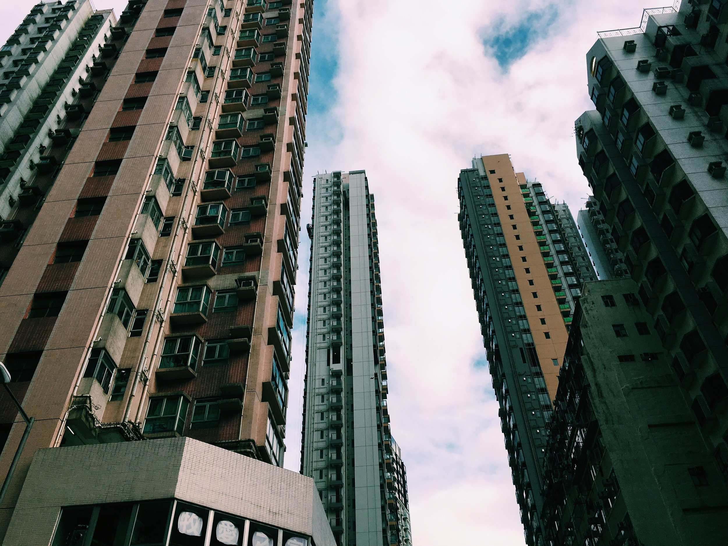 Apartments look similar and exist as new and old right next to each other in Hong Kong.