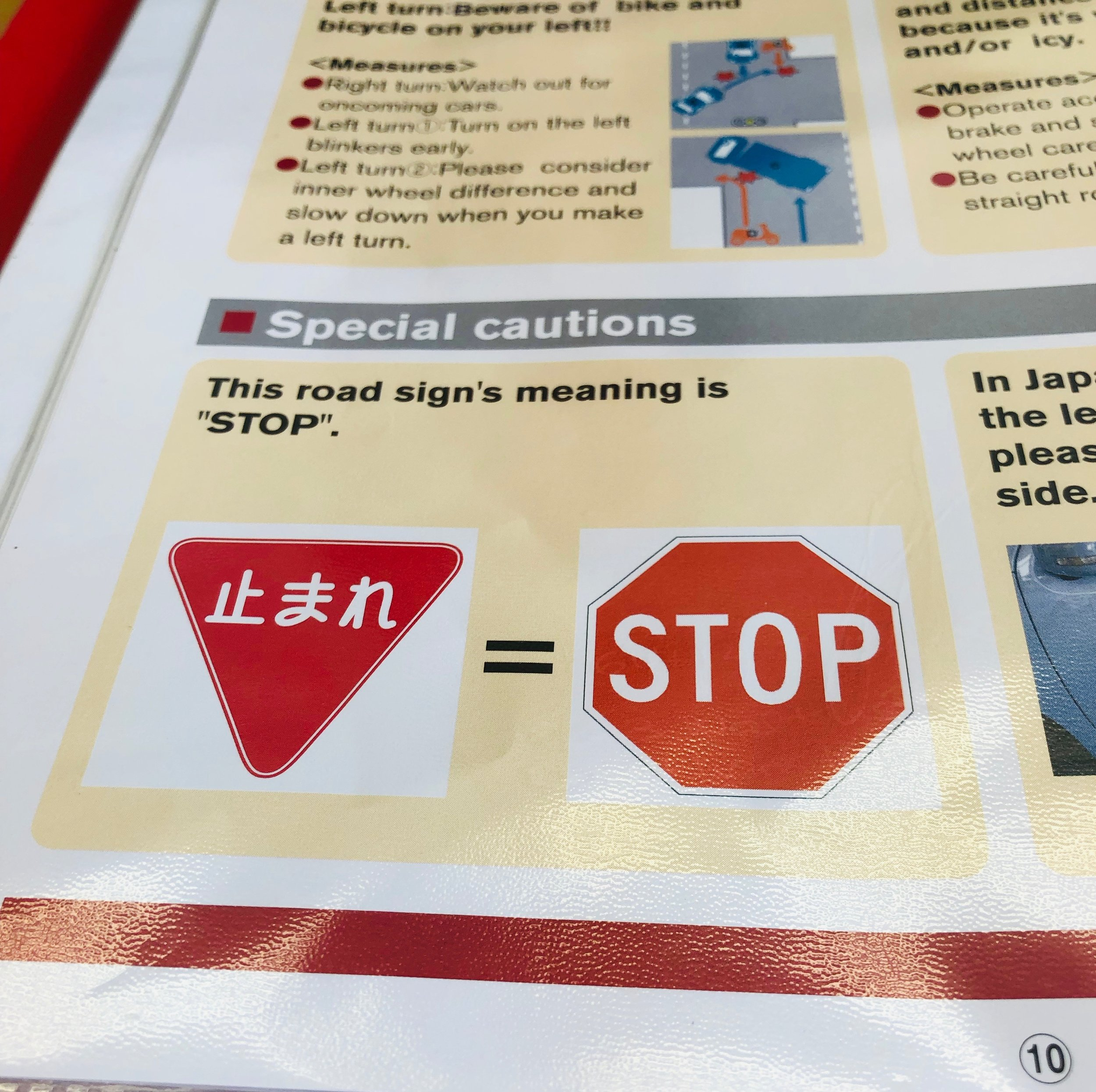 Red means stop. Stop sign in Japanese is an inverted red triangle.