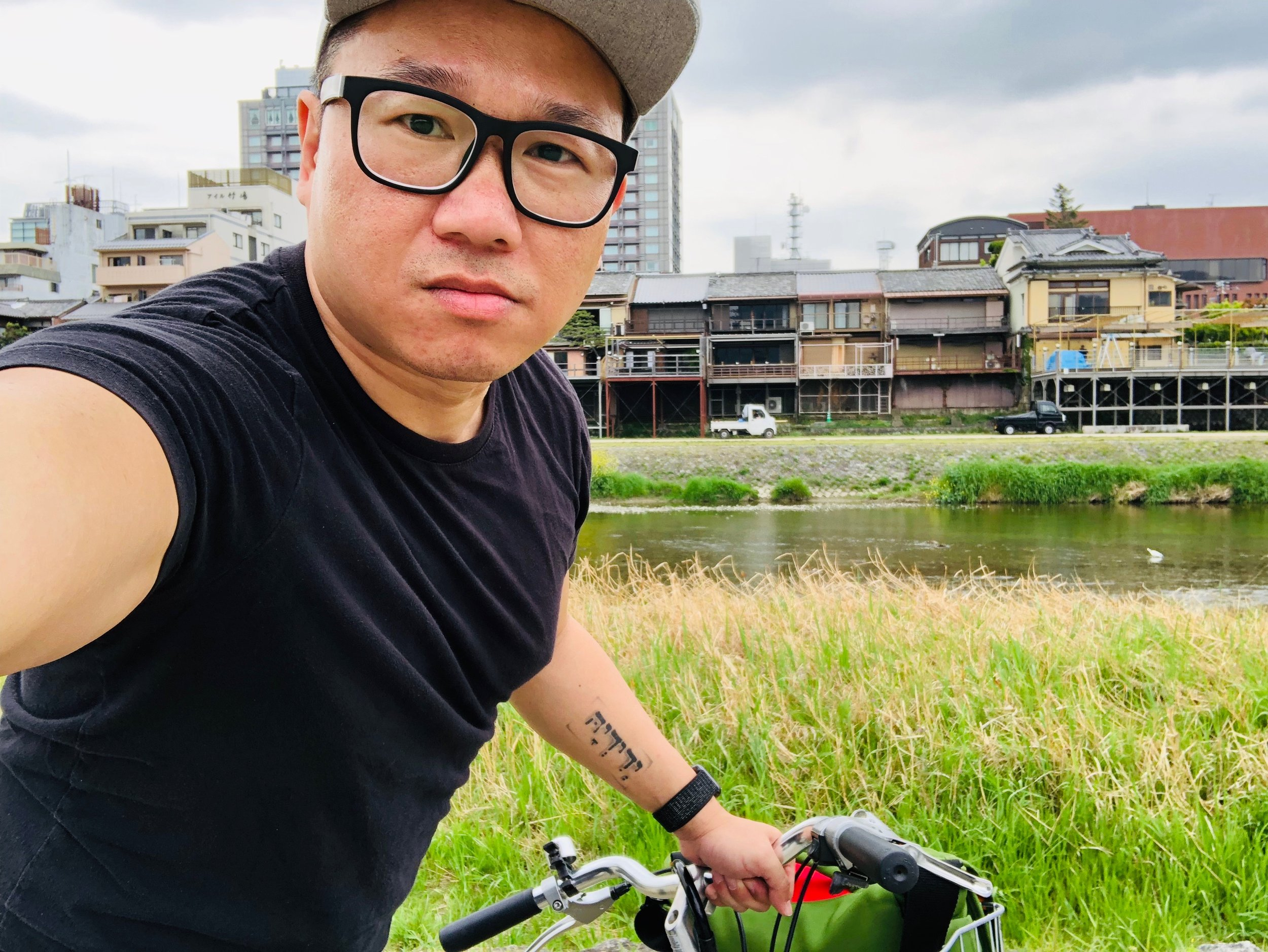 Cycling along the river in Kyoto.