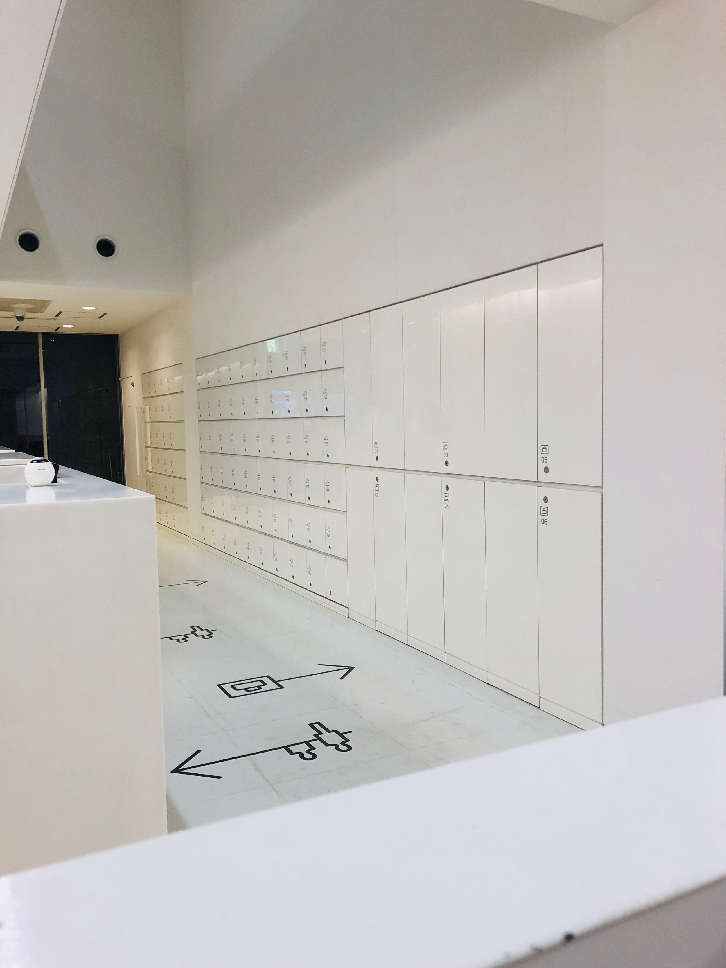 Reception area of Nine Hours, Kyoto. Shoe lockers and luggage storage.