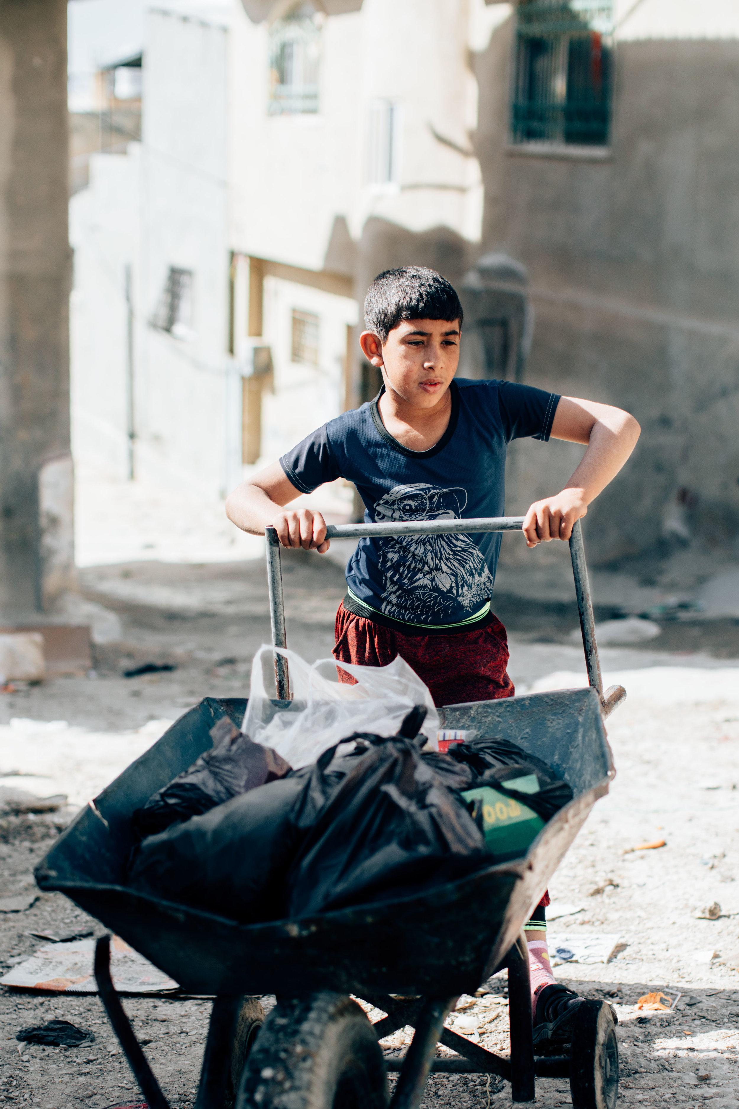 UNRWA JERASH CAMP, HE WORKS.jpg