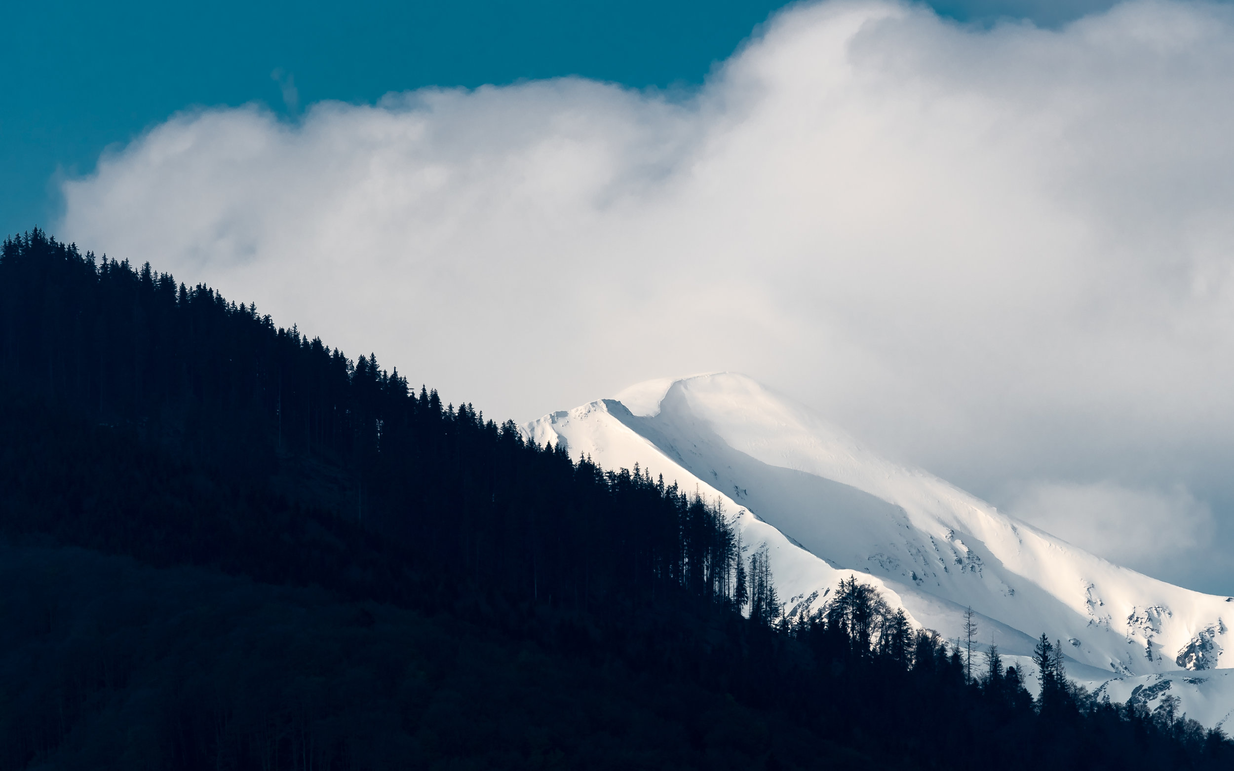 Snowy peaks of the Carpathians in the clouds