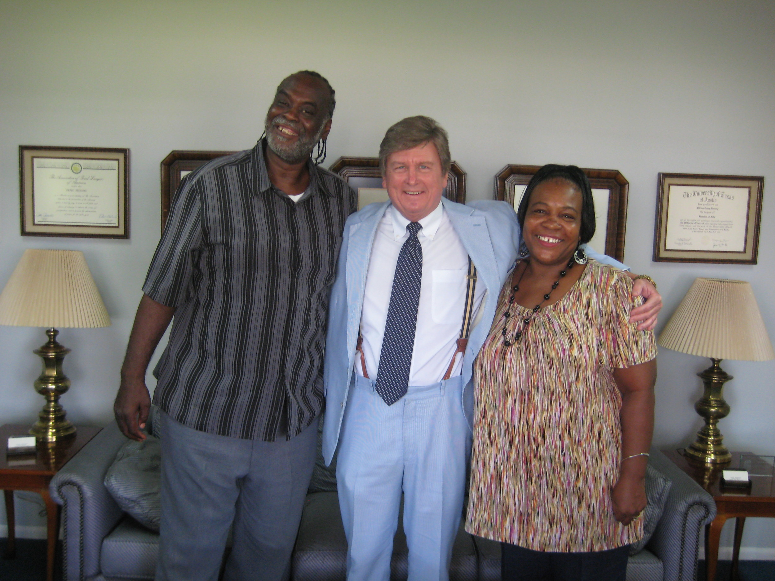 After a long battle with two major insurance companies, Muessig is pictured celebrating a $500,000 settlement with his client Bobby Robinson and his wife Andrea. Robinson was injured in a Katy auto accident and underwent successful neck surgery.