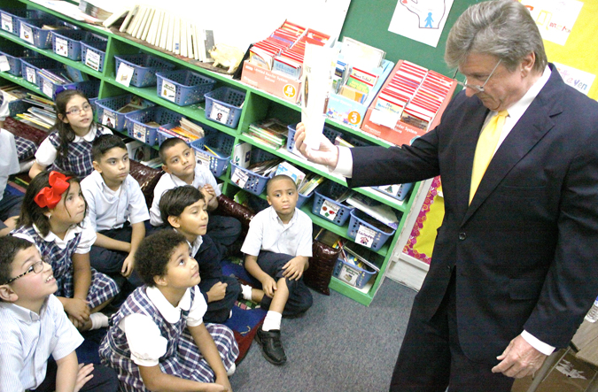 Pictured above is Craig Muessig showing a third grade class a book about the U.S. Constitution in Baytown. Muessig visited St. Joseph Catholic School to speak to youth about Constitution Day and the importance it has in American history.