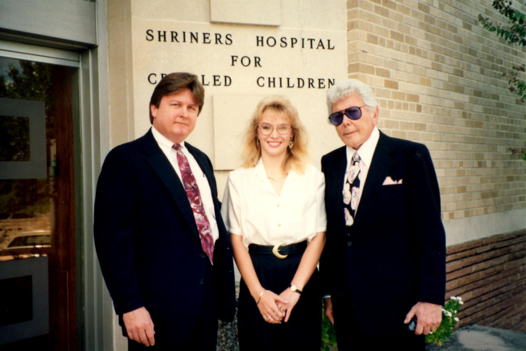 Pictured above is Muessig with his client, Dayton resident Lee Ann West, and the legendary Marvin Zindler. Muessig and Zindler were arranging for West to have lower back surgery at the Shriners Hospital for Crippled Children for injuries sustained in an auto accident.