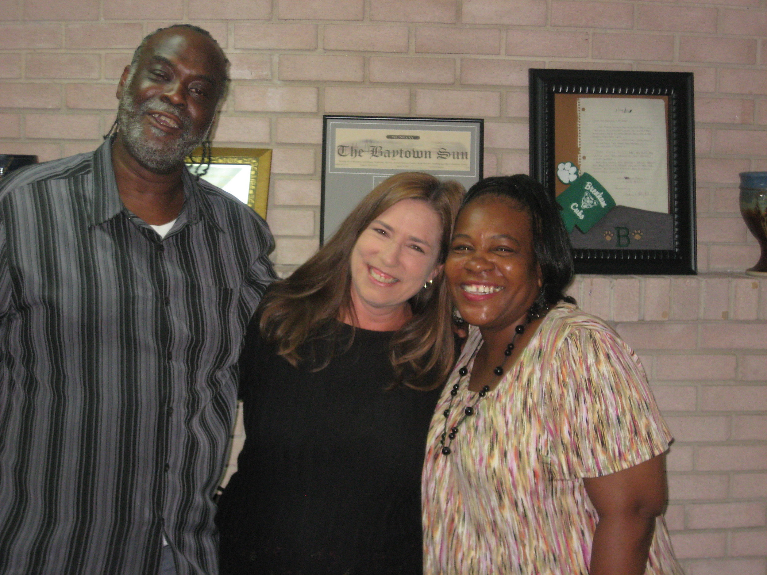 """Pictured with clients Bobby and Andrea Robinson is legal assistant, Debra Davis, a Barbers Hill native. Debra has been with the Law Offices of Craig Muessig for the last 18 years and, """"is loved by our clients,"""" according to Muessig."""