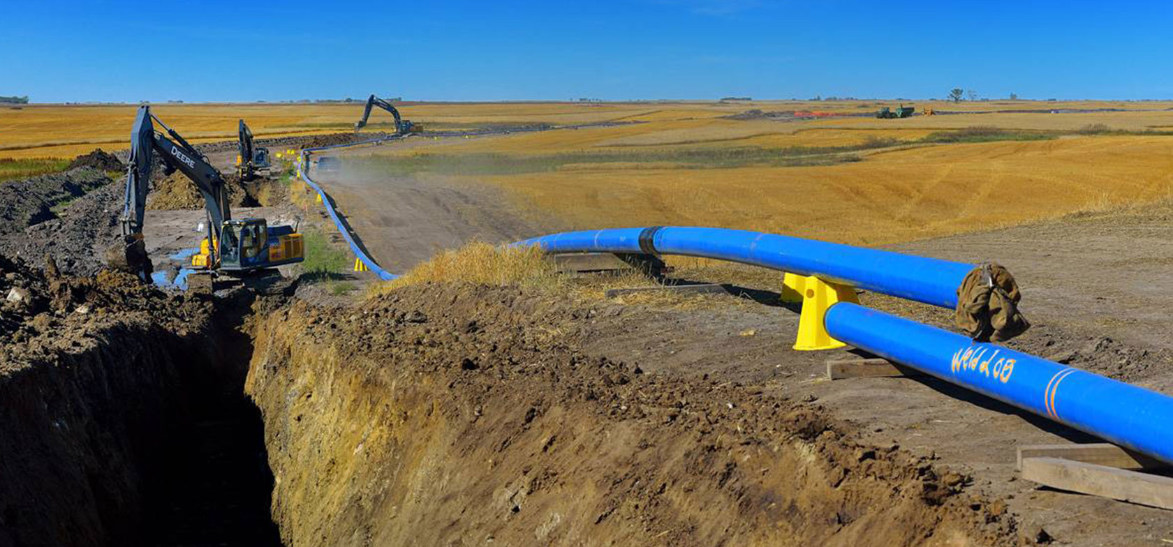 NTL Pipelines uses mobile forms to complete a pipeline project, laying blue pipe in an open field