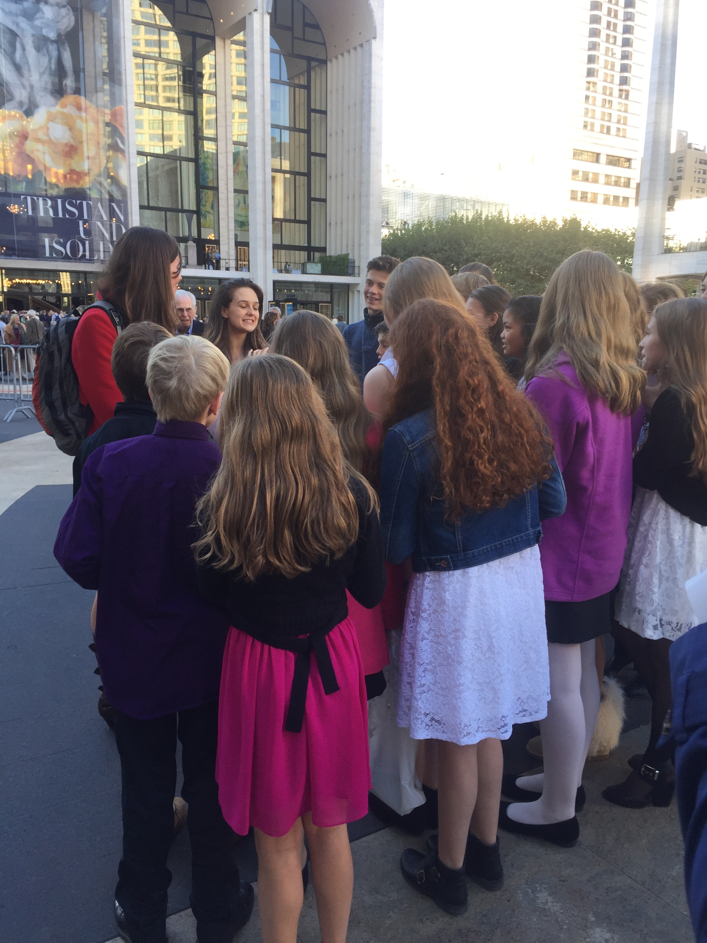 Lauren visits with some aspiring dancers and fans after a show, telling them about PerfectFit.