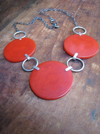 Bakelite necklace,   3 red bakelite circles, riveted rings, sterling silver chain