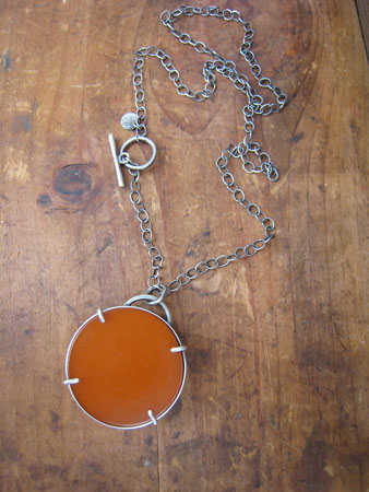 Double-sided bakelite necklace,   pumpkin and dark green bakelite, prong settings, sterling silver chain,   sold