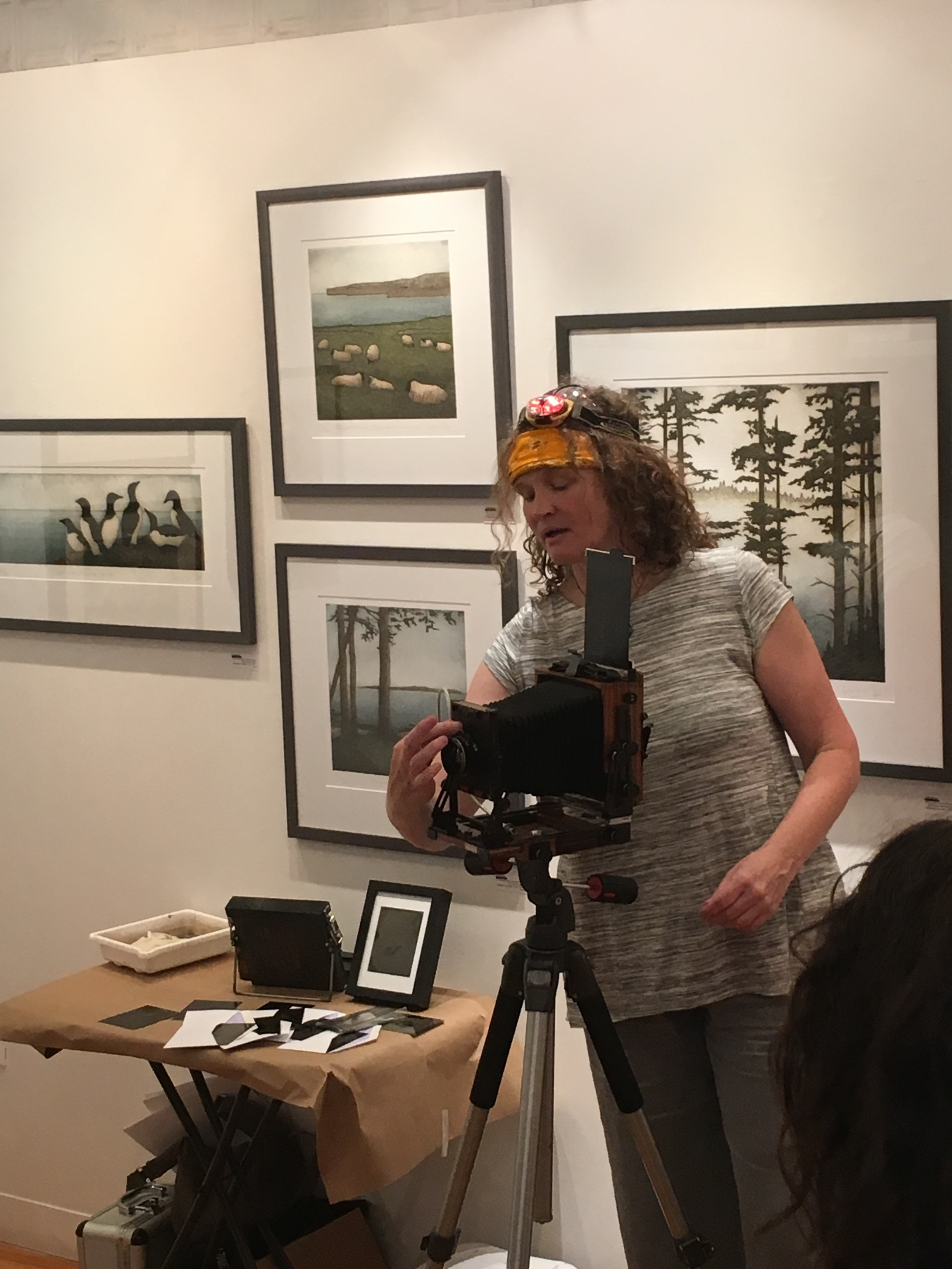 Silke Hase demonstrates various pieces of equipment used in the wet plate collodion process.