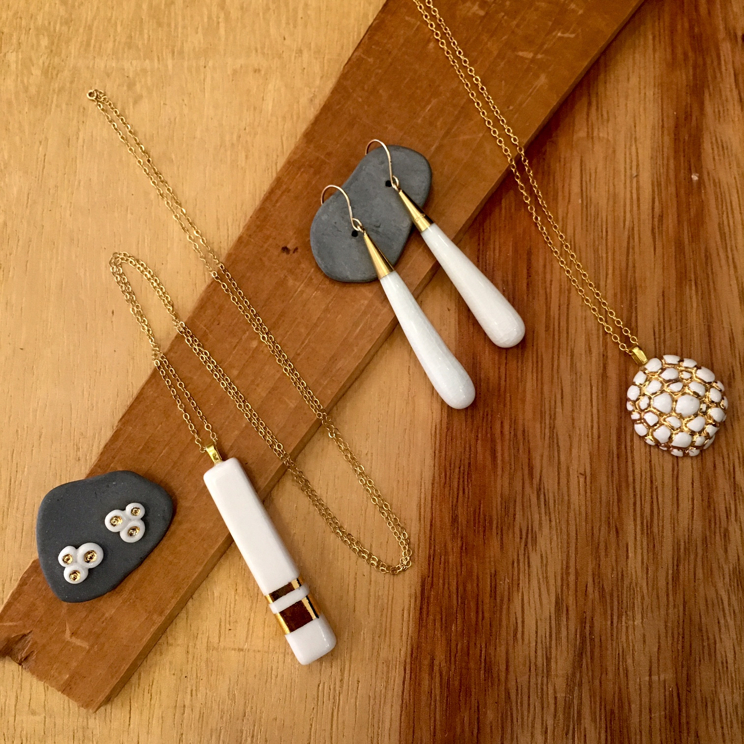 Assorted earrings and necklaces, porcelain and gold, prices vary