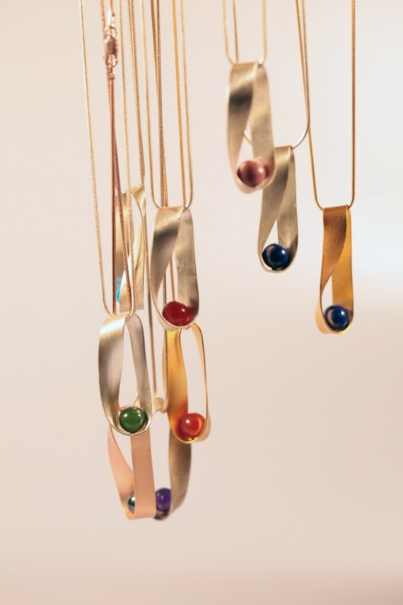 Mobius  necklaces, assorted stones with sterling silver $110, with gold plate $130