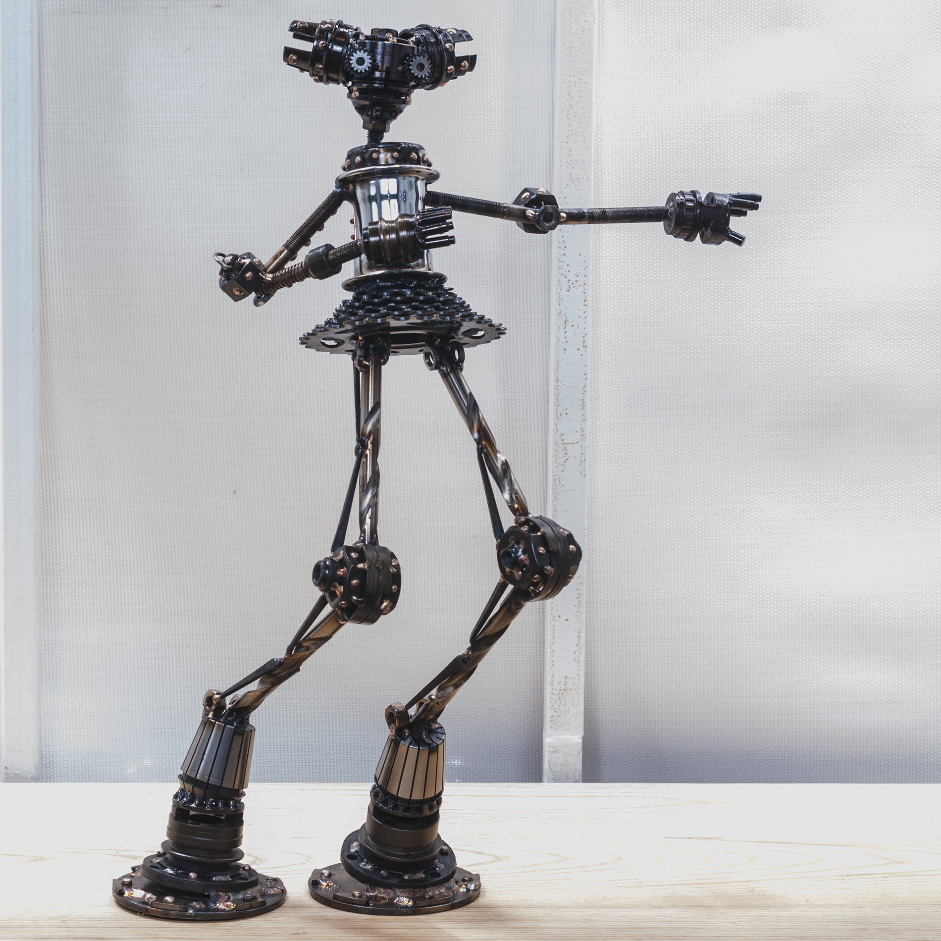 """Gloria #M295 , Mercury class astrobot: bicycle parts. blades, washers, collets, pipe flanges, nuts, drill bits, nails, bolts, copper, bronze, stainless steel, 21"""" x 14"""" x 7"""", sold"""