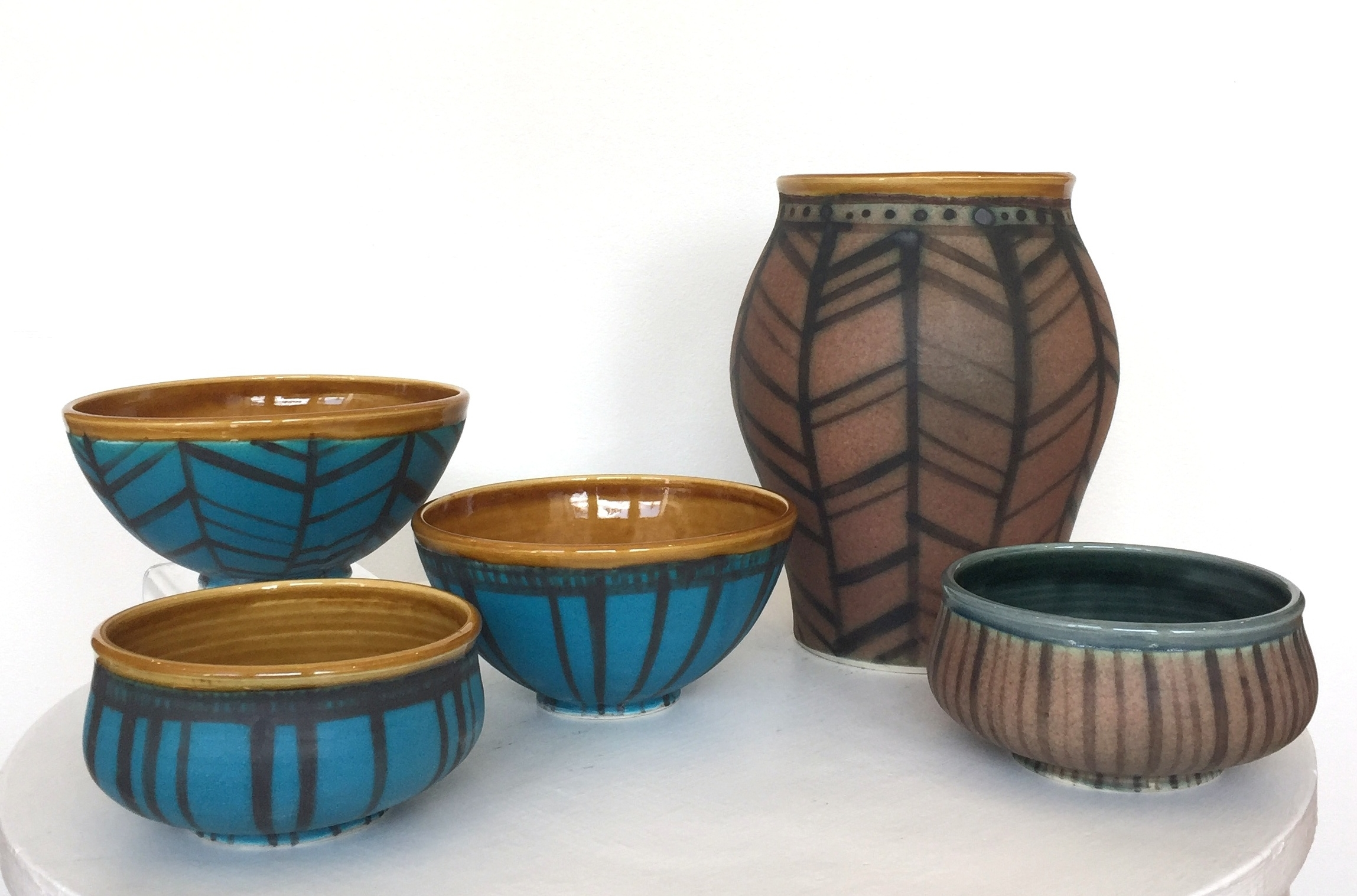 Ceramic vase and bowls, herringbone and stripe patterns, $38-$175