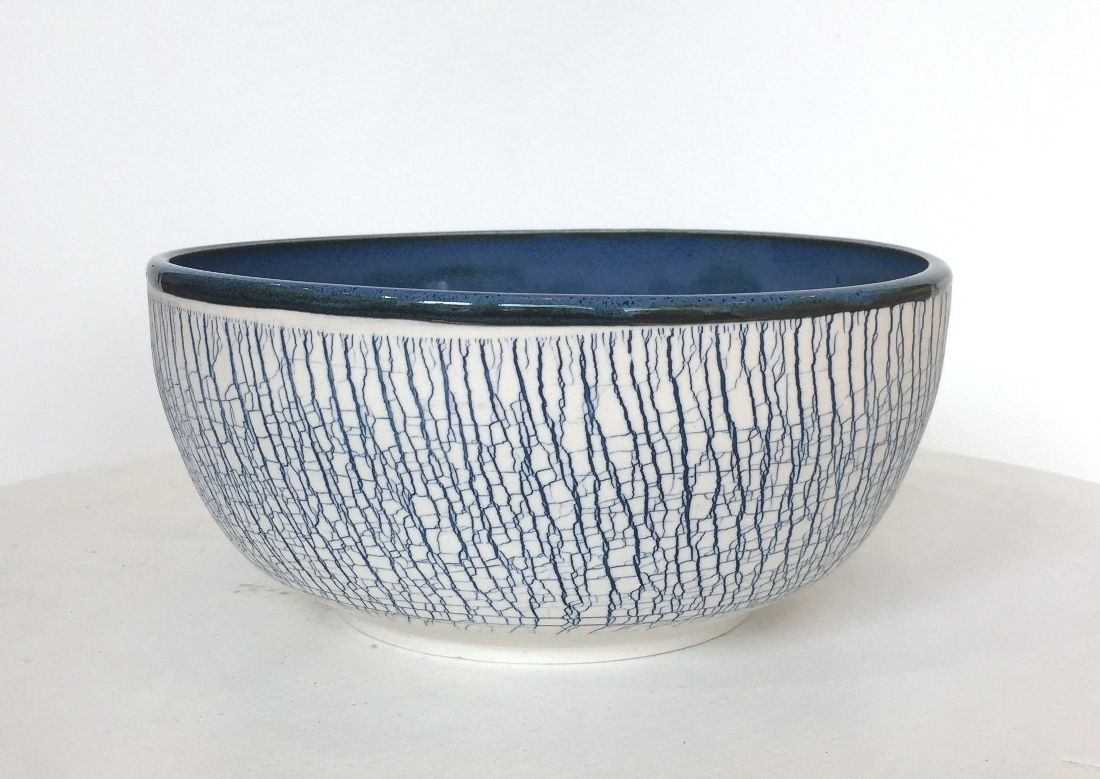 "Large blue serving bowl, 4"" x 8 1/2"", $125"