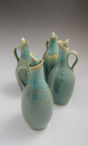 "Green cruet, hand-thrown stoneware, 8"" x 3"", $68"