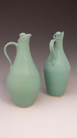 "Matte green cruet, hand-thrown stoneware, 8"" x 3"", $68"