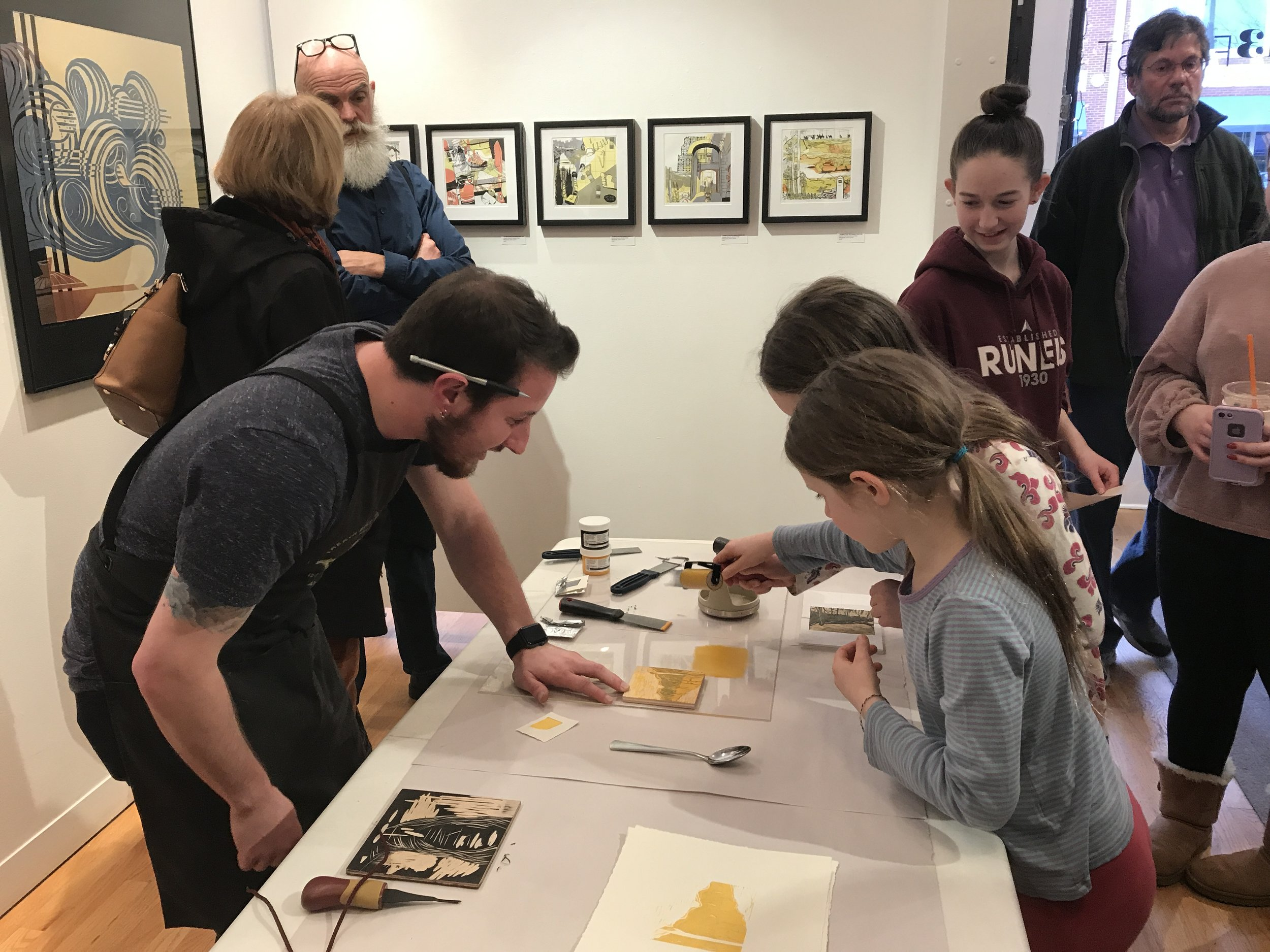Stearns helping some budding artists make their own prints.