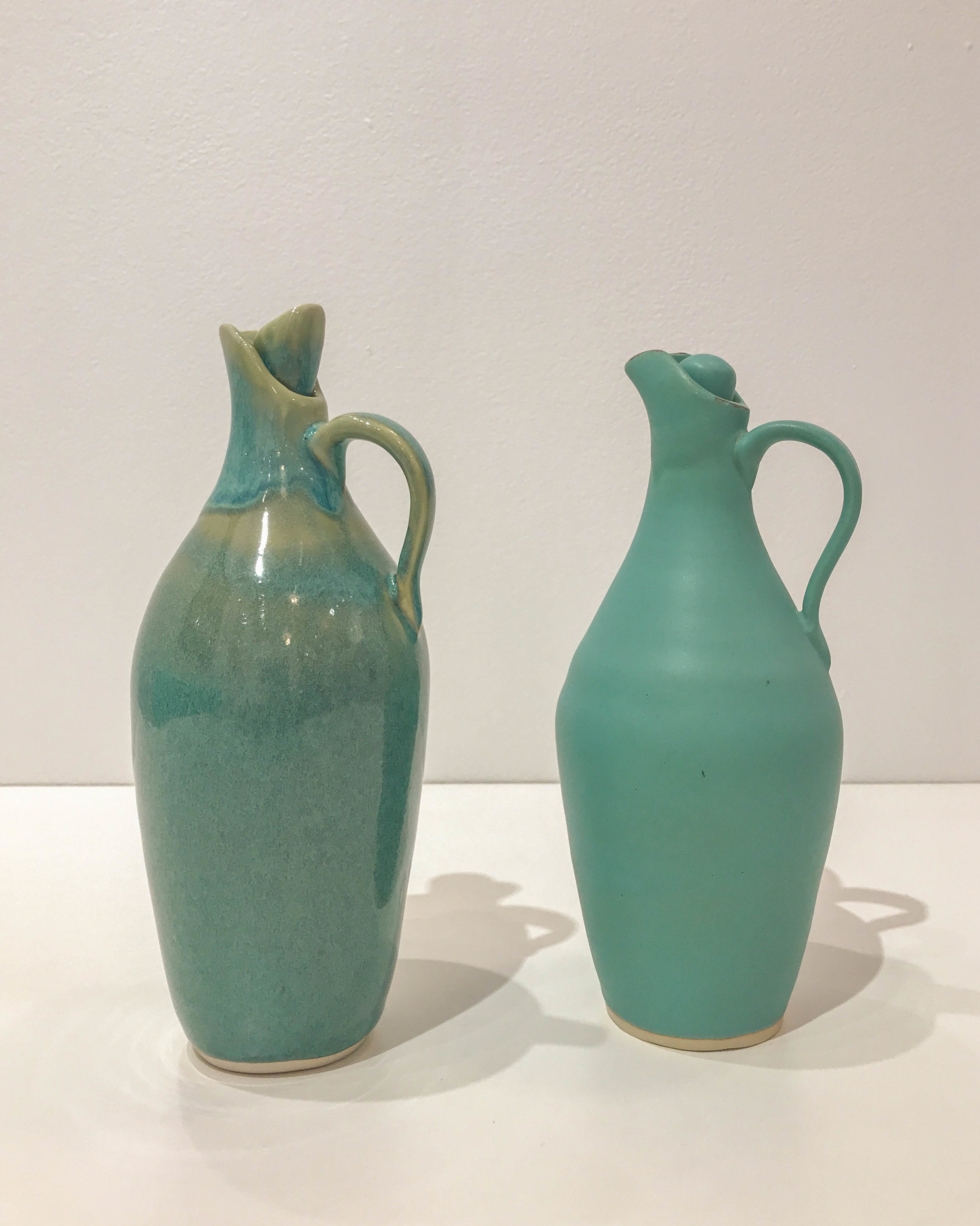 "Jennifer Crowe , matte green cruets, hand-thrown stoneware, 8"" x 3"", $68 each"