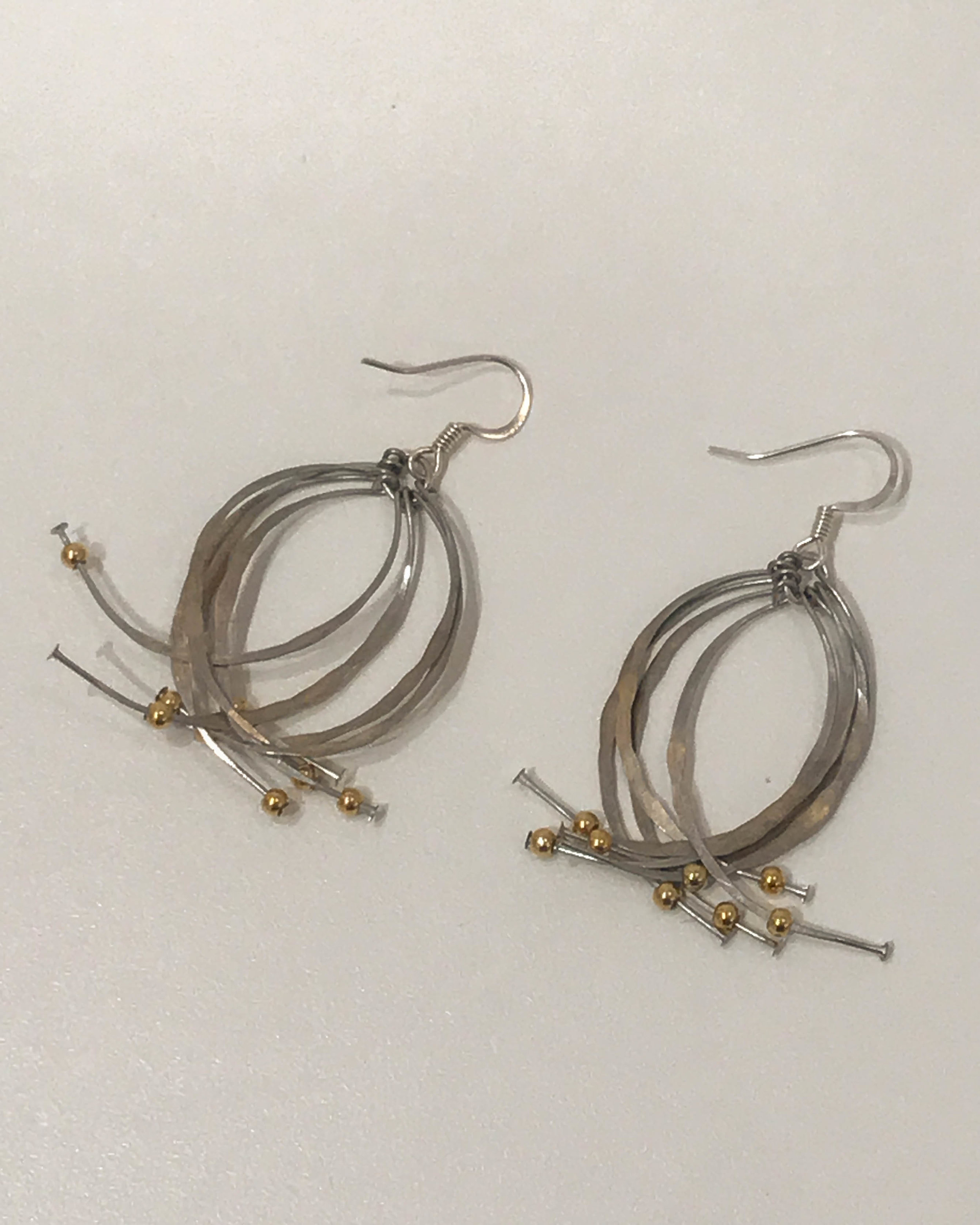 Two-tone Kinetic earrings , silver and gold-filled beads, $45