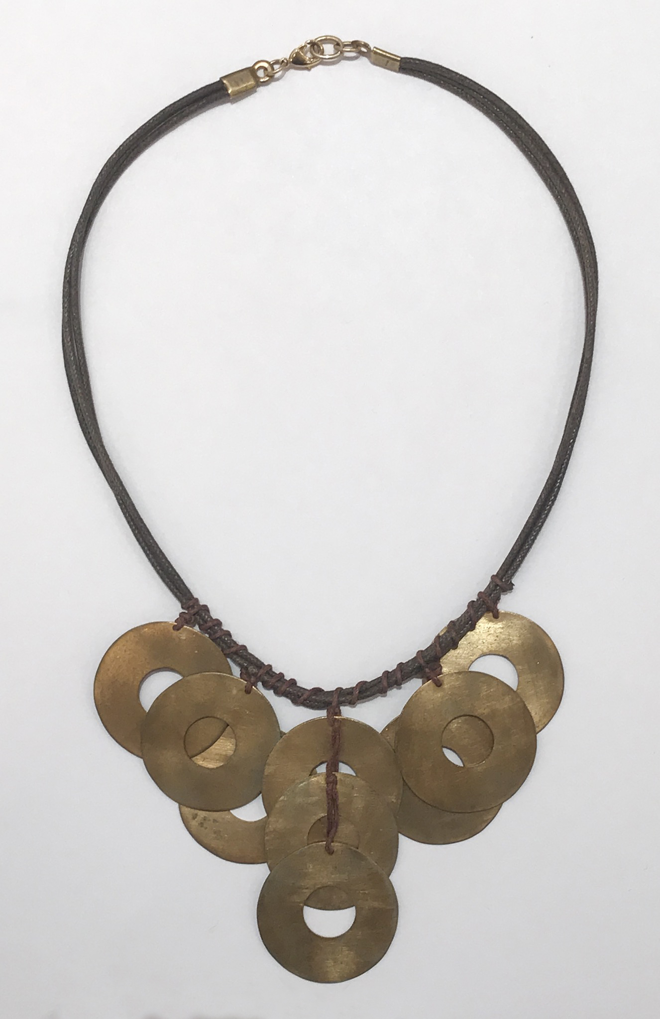 Tribal necklace , brass washers on brown cord with gold plated clasp, sold