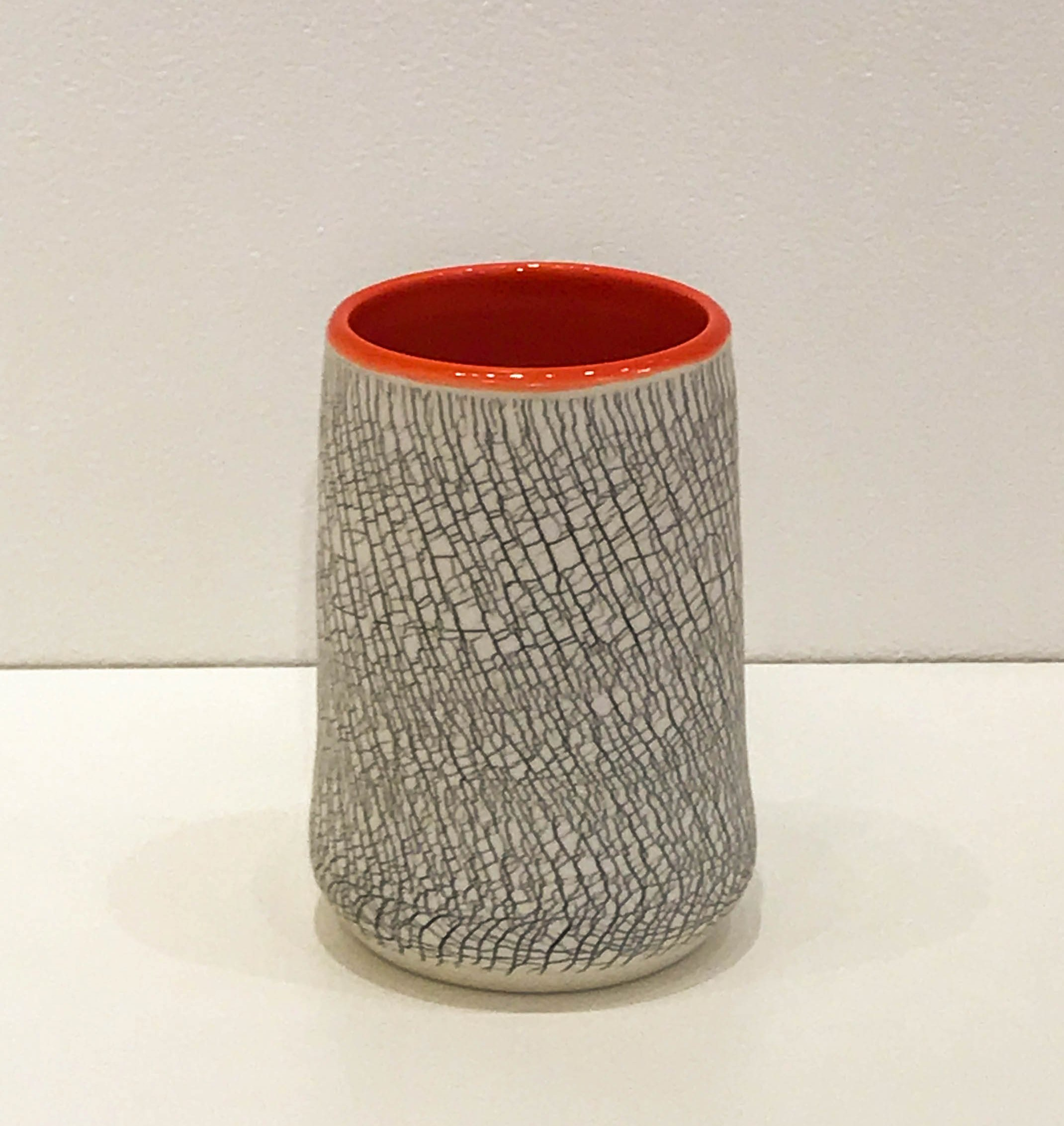"Wheel-thrown and hand-altered tumbler with black crackle and orange glazed interior, 4 1/2"" x 2 3/4"" x 2 3/4"",sold"