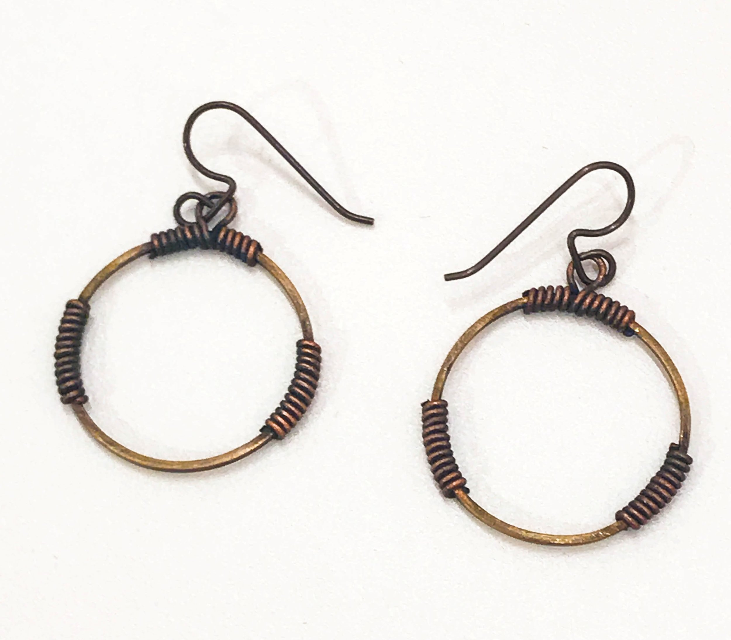 "Brass circle with wrapped copper wire earrings, 1 3/4"" x 1"", $45"