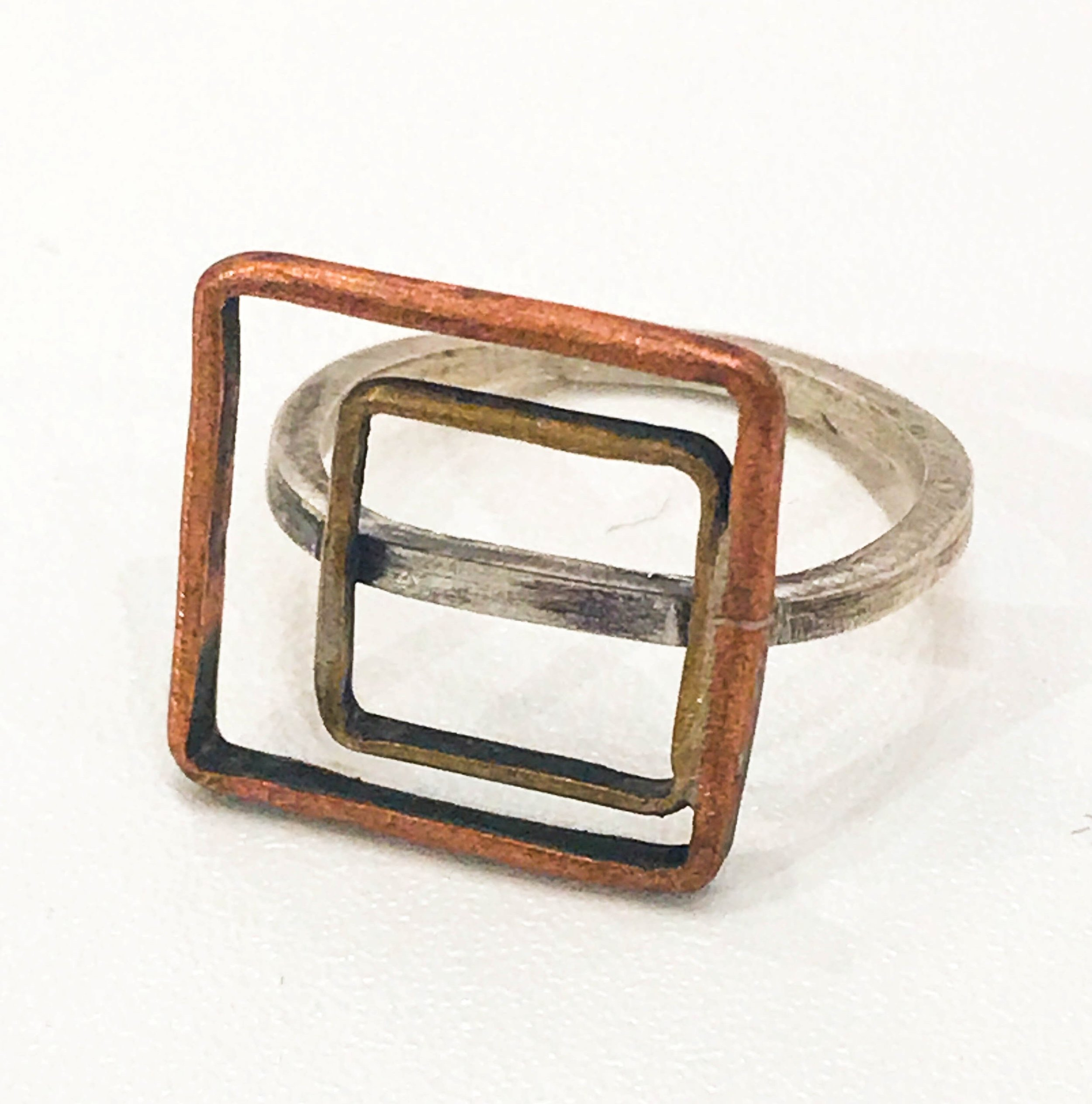 Sterling silver ring with with open copper and brass squares, $60