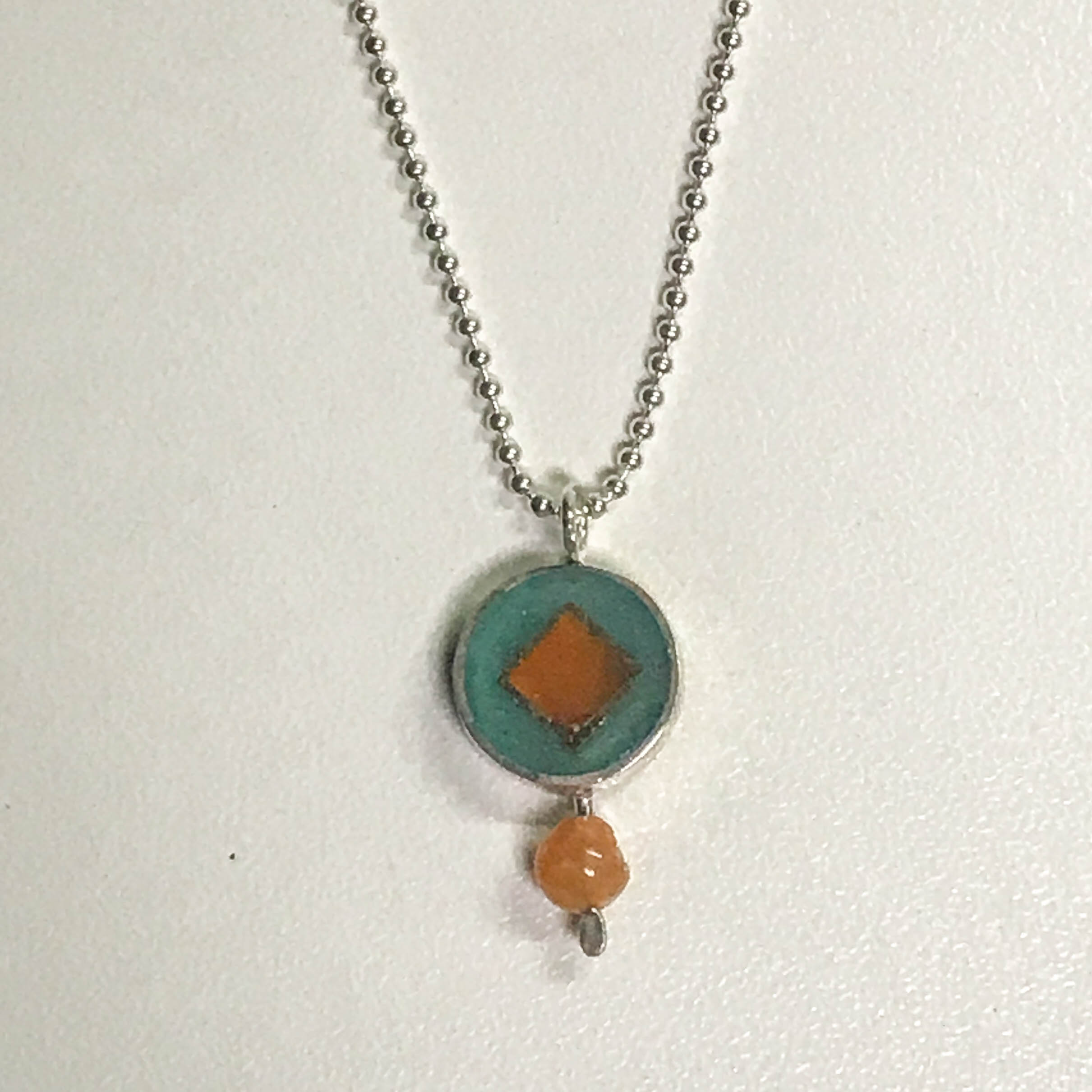 Round pendant drop necklace, sterling silver with resin inlay, orange quartz bead, sterling silver bead chain, $80