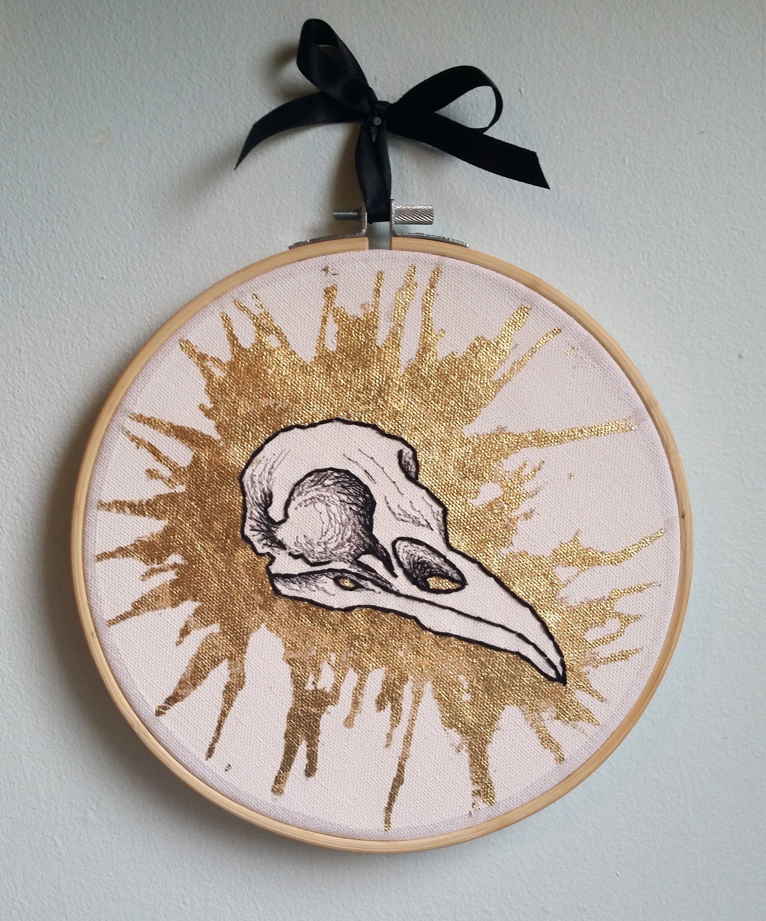 "Corvus corax (Common raven) , metal leaf, thread, and embroidery floss on canvas, 8"" x 8"", $300"
